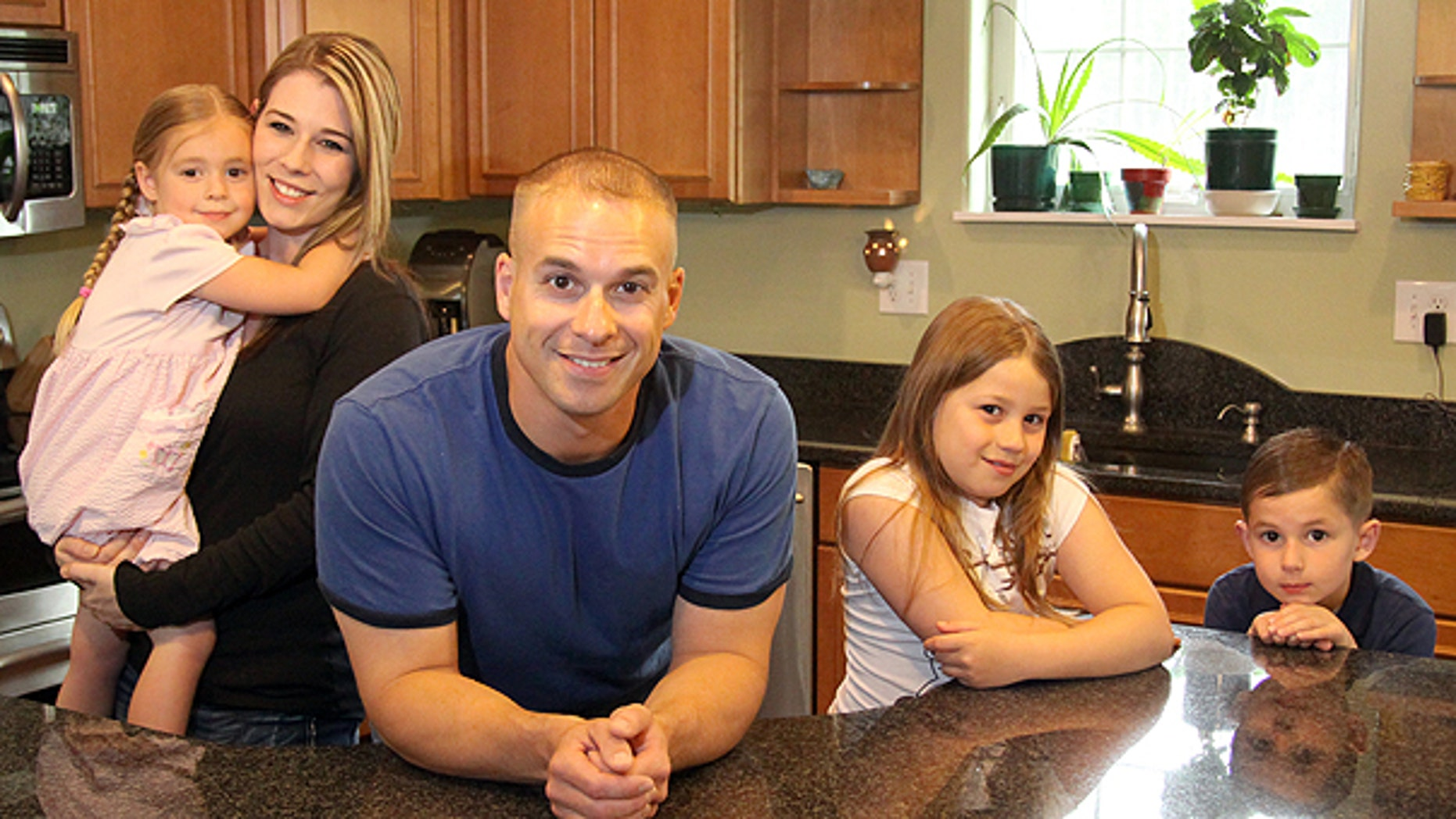 June 8: James Tritle with his wife Angela and their children BreAnna, Makayla and Cameron pose for a photo at their home in North Pole, Alaska.
