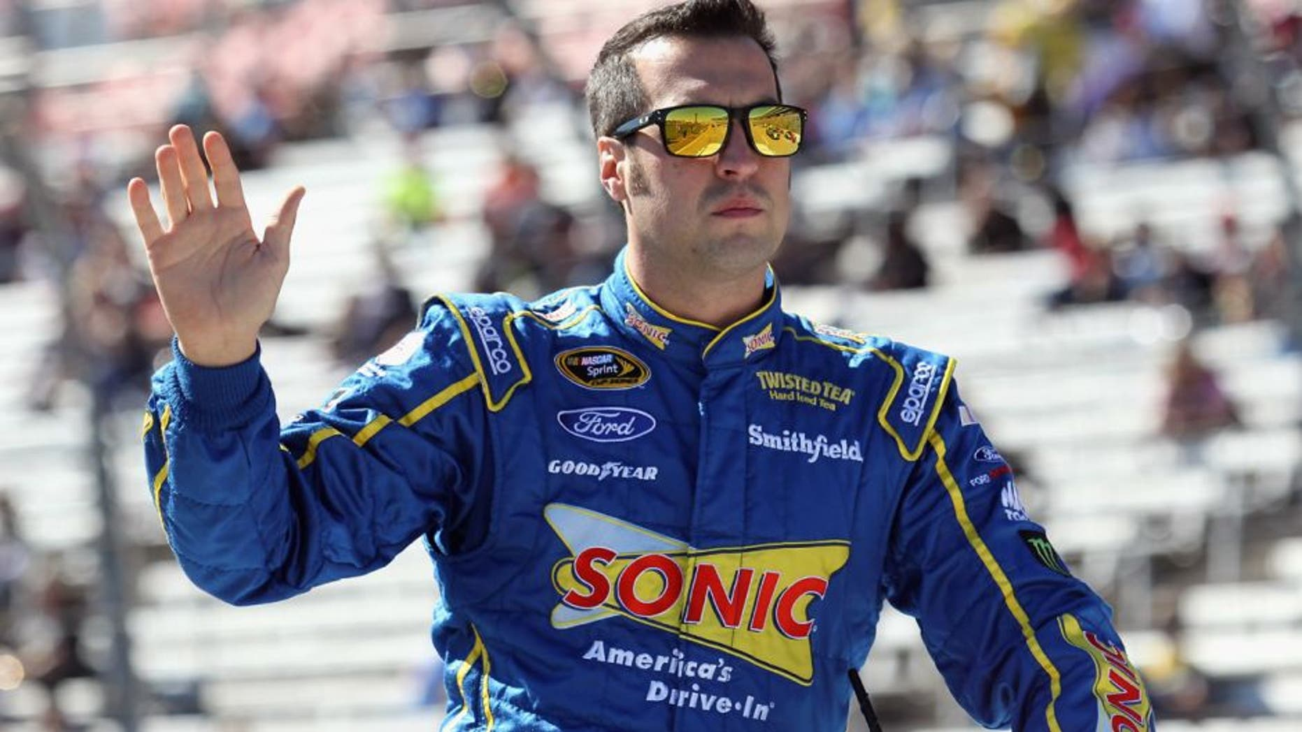 FORT WORTH, TX - NOVEMBER 08: Sam Hornish Jr., driver of the #9 Sonic Ford, greets fans from a parade vehicle during pre-race ceremonies for the NASCAR Sprint Cup Series AAA Texas 500 at Texas Motor Speedway on November 8, 2015 in Fort Worth, Texas. (Photo by Tim Bradbury/Getty Images for Texas Motor Speedway)