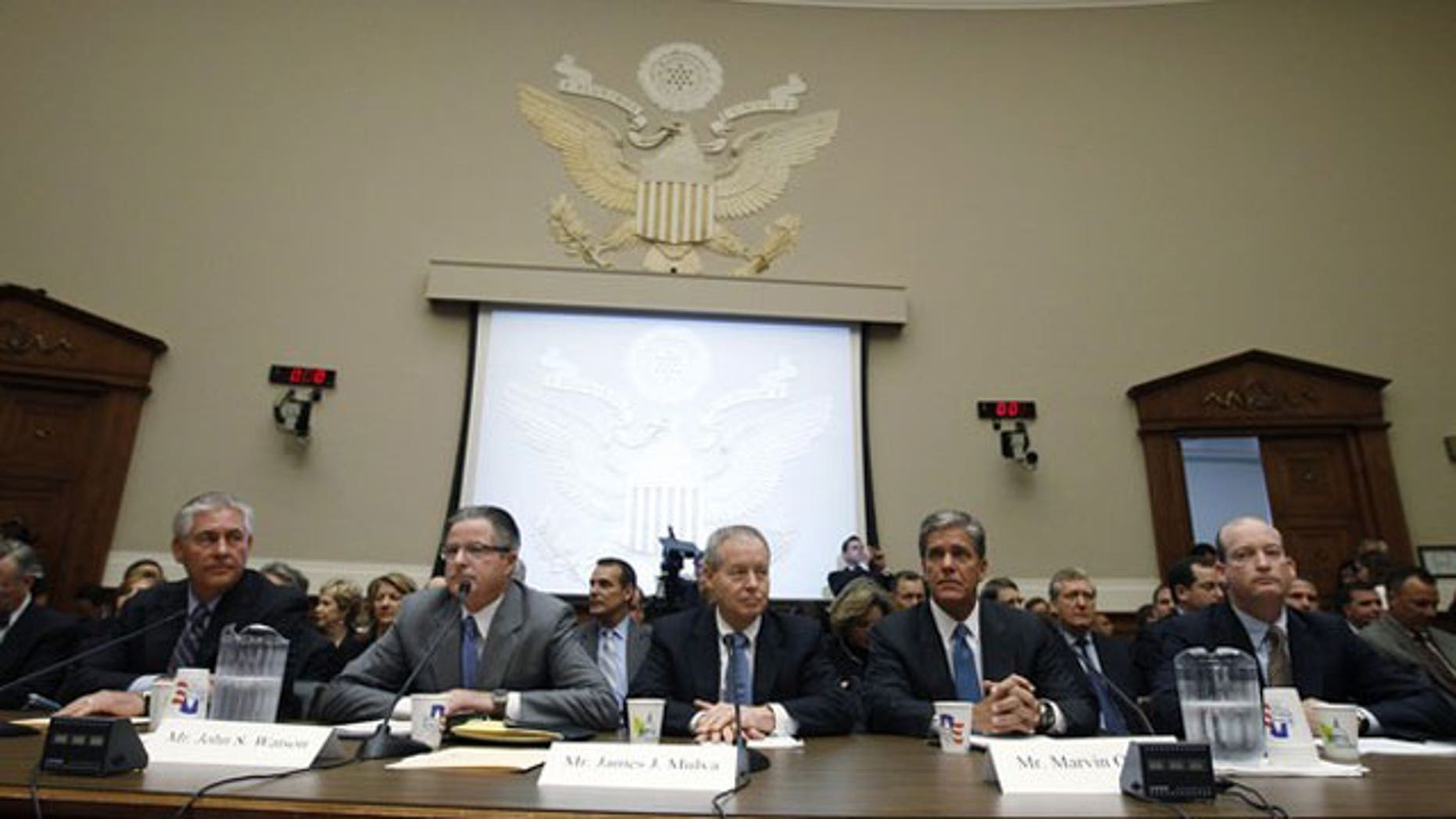 June 15: Oil company executives, (L-R) ExxonMobil Chairman and CEO Rex Tillerson, Chevron Chairman and CEO John Watson, ConocoPhillips Chairman and CEO James Mulva, Shell Oil Company President Marvin Odum and BP America Inc President and Chairman Lamar McKay testify on the BP oil spill in the Gulf of Mexico during a House Energy and Commerce hearing on Capitol Hill in Washington (Reuters).
