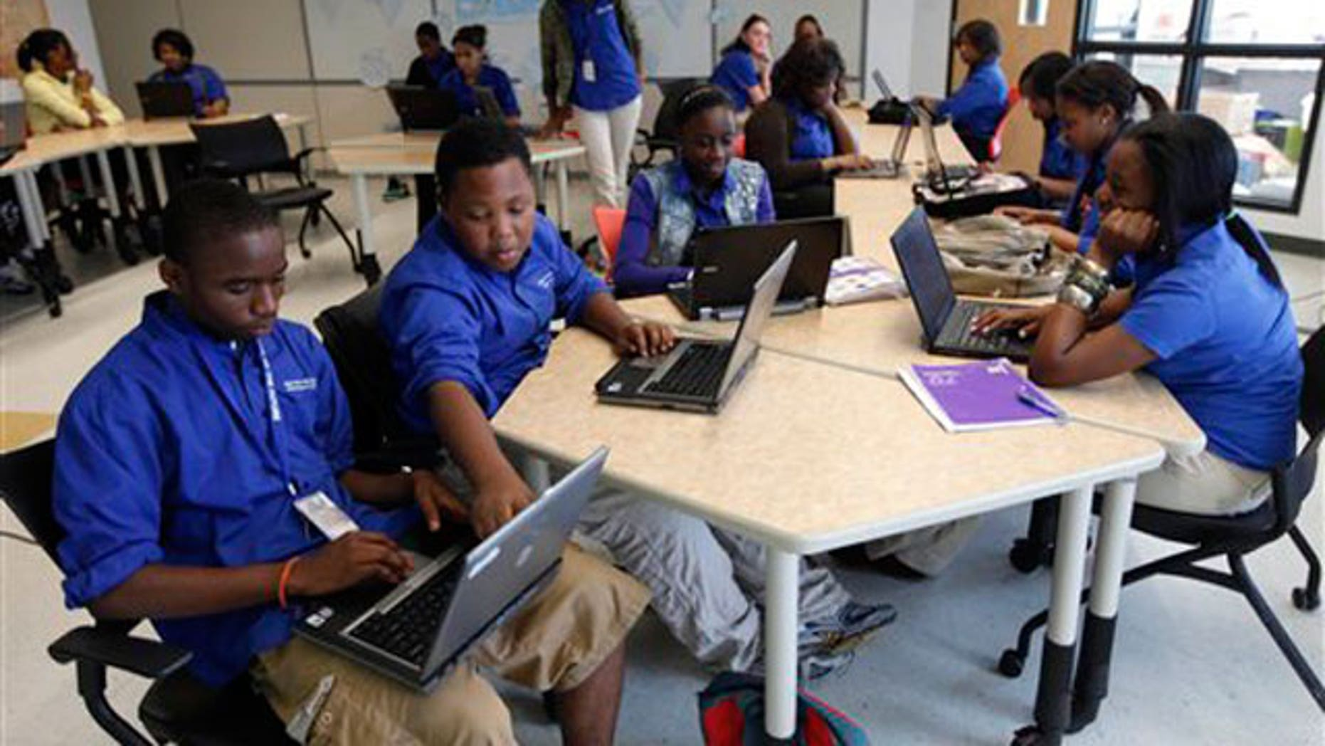 May 20: students use laptop computers in the classroom at the 'School of the Future' in Philadelphia.
