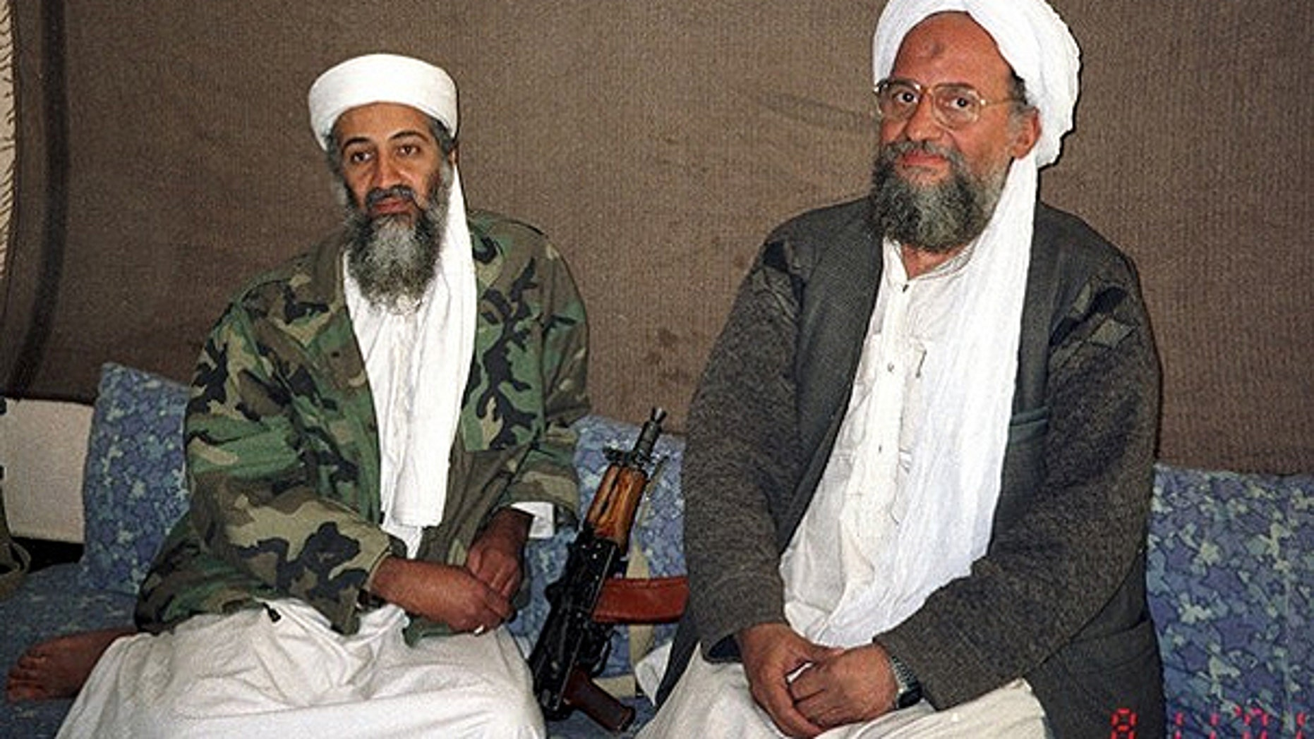 Nov. 10, 2001: Usama bin Laden sits with his adviser and purported successor Ayman al-Zawahiri, an Egyptian linked to the Al Qaeda network, during an interview with Pakistani journalist Hamid Mir (not pictured) in an image supplied by the respected Dawn newspaper.