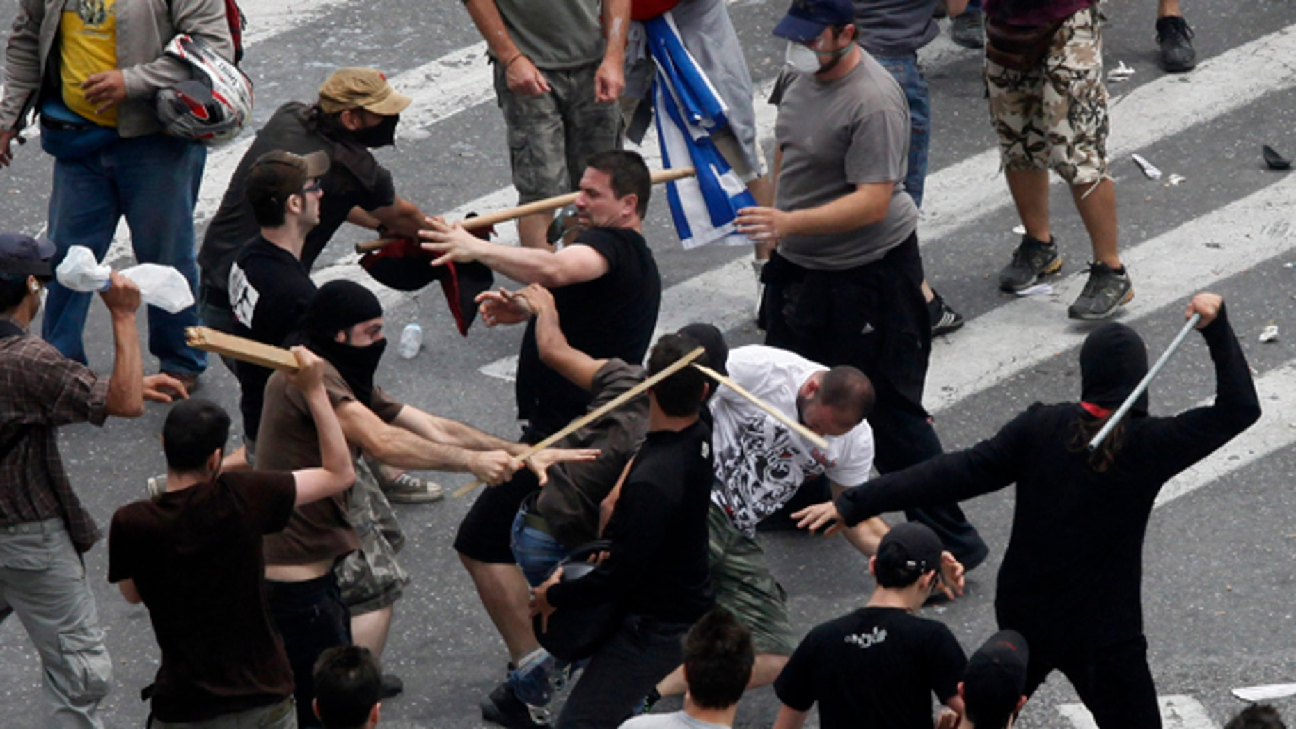 June 15: Left and right wing demonstrators fight at Syntagma square in front of the Greek Parliament in central Athens, during a rally against the new austerity measures.