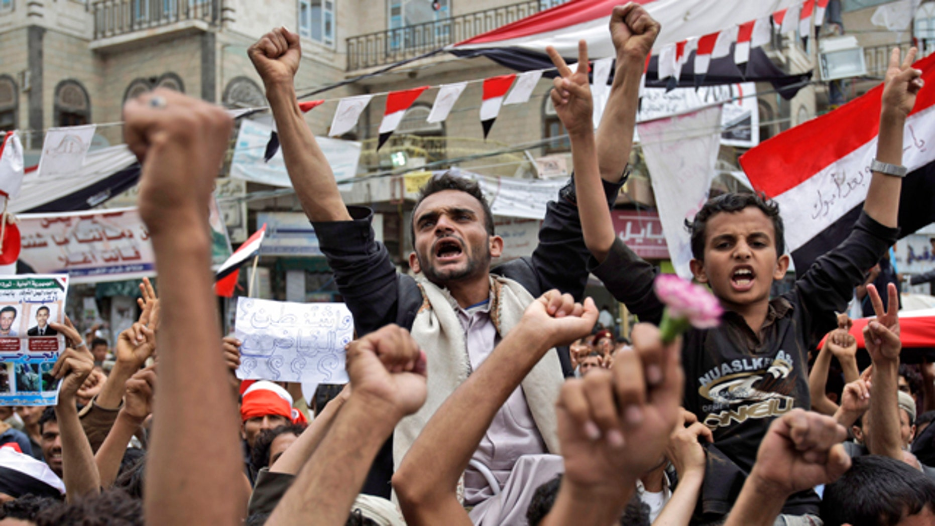 June 15: Anti-government protestors chant slogans during a demonstration demanding the resignation of Yemeni President Ali Abdullah Saleh, in Sanaa, Yemen.