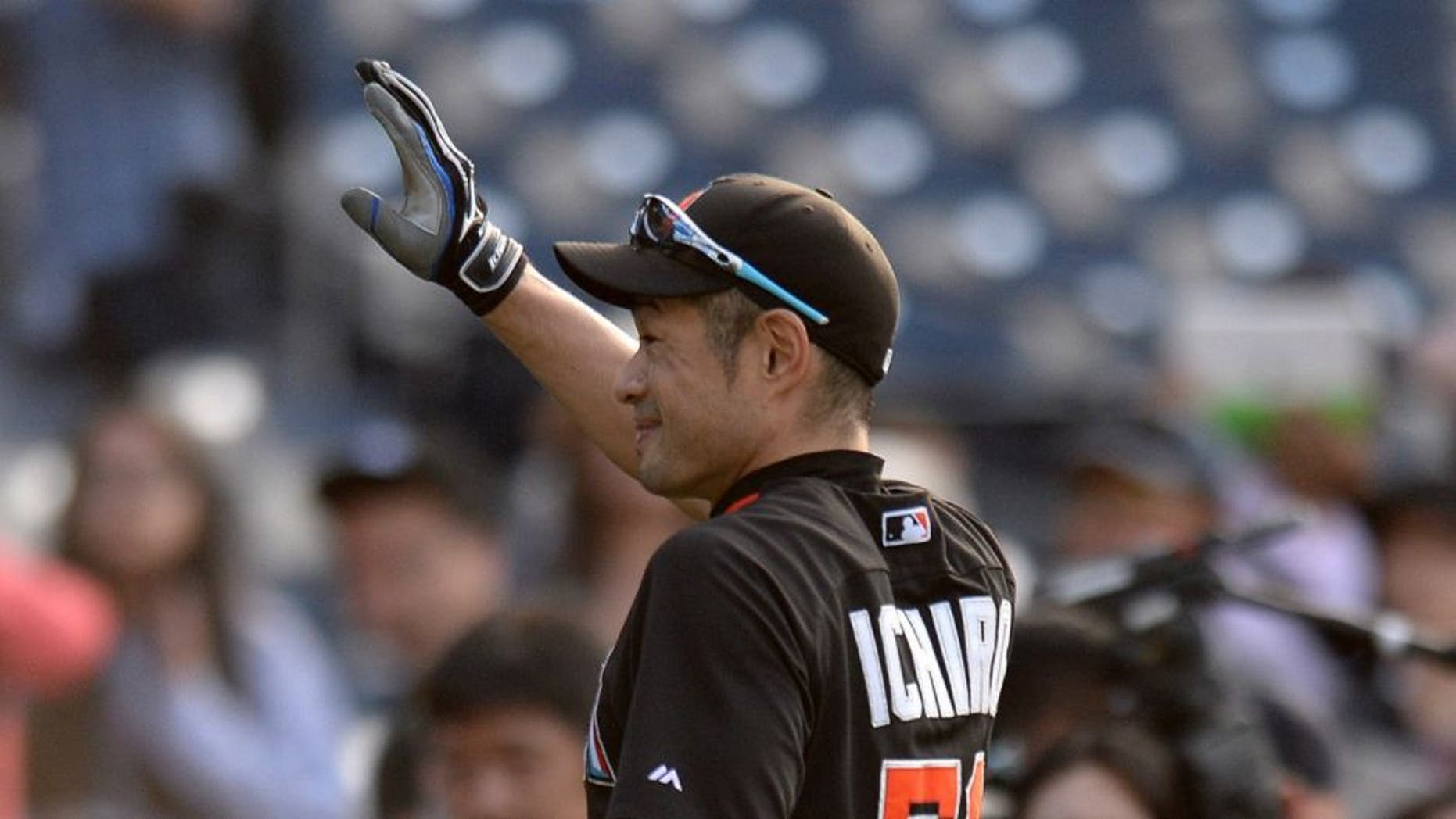 Jun 14, 2016; San Diego, CA, USA; Miami Marlins center fielder Ichiro Suzuki (51) waves to the crowd prior to the game against the San Diego Padres at Petco Park. Mandatory Credit: Jake Roth-USA TODAY Sports