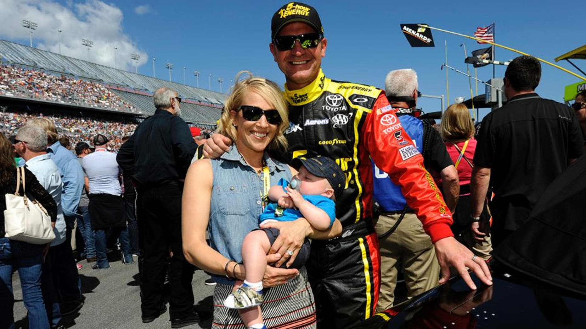 DAYTONA BEACH, FL - FEBRUARY 22: Clint Bowyer, driver of the #15 5-hour ENERGY Toyota, wife Lorra and son Cash Aaron pose for a picture on the grid prior to the NASCAR Sprint Cup Series 57th Annual Daytona 500 at Daytona International Speedway on February 22, 2015 in Daytona Beach, Florida. (Photo by Jared C. Tilton/Getty Images)