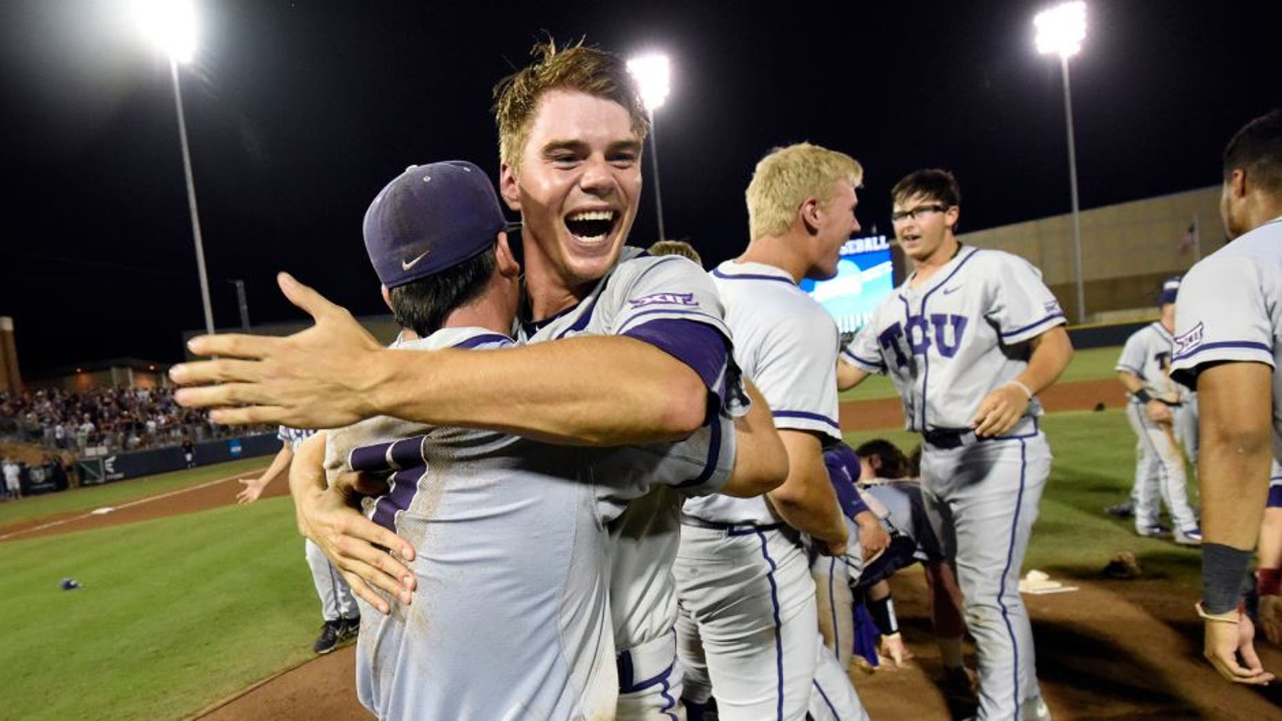 TCU's Connor Wanhanen, right, celebrates with teammate Josh Watson (7) after defeating Texas A&M 4-1 in a NCAA college baseball Super Regional tournament game, Sunday, June 12, 2016, in College Station, Texas. (AP Photo/Sam Craft)