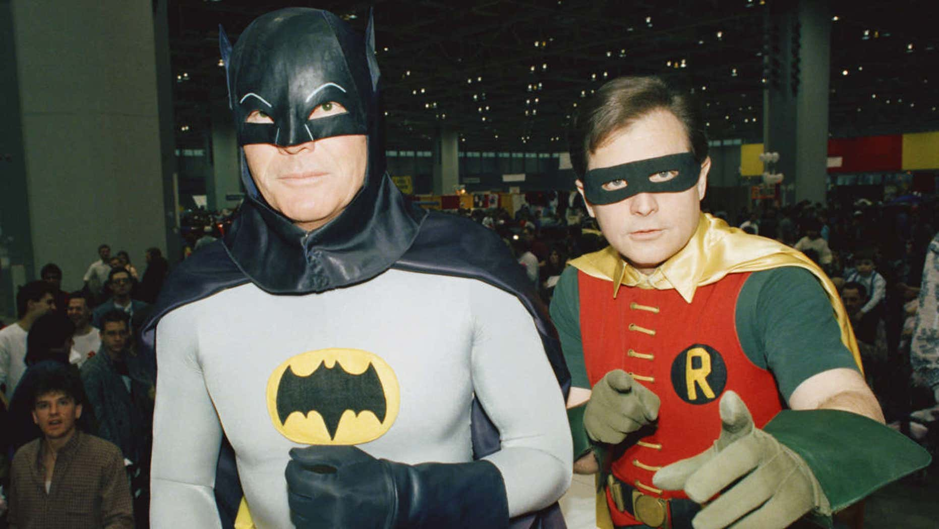 """FILE - In this Jan. 27, 1989, file photo, actors Adam West, left, and Burt Ward, dressed as their characters Batman and Robin, pose for a photo at the """"World of Wheels"""" custom car show in Chicago."""