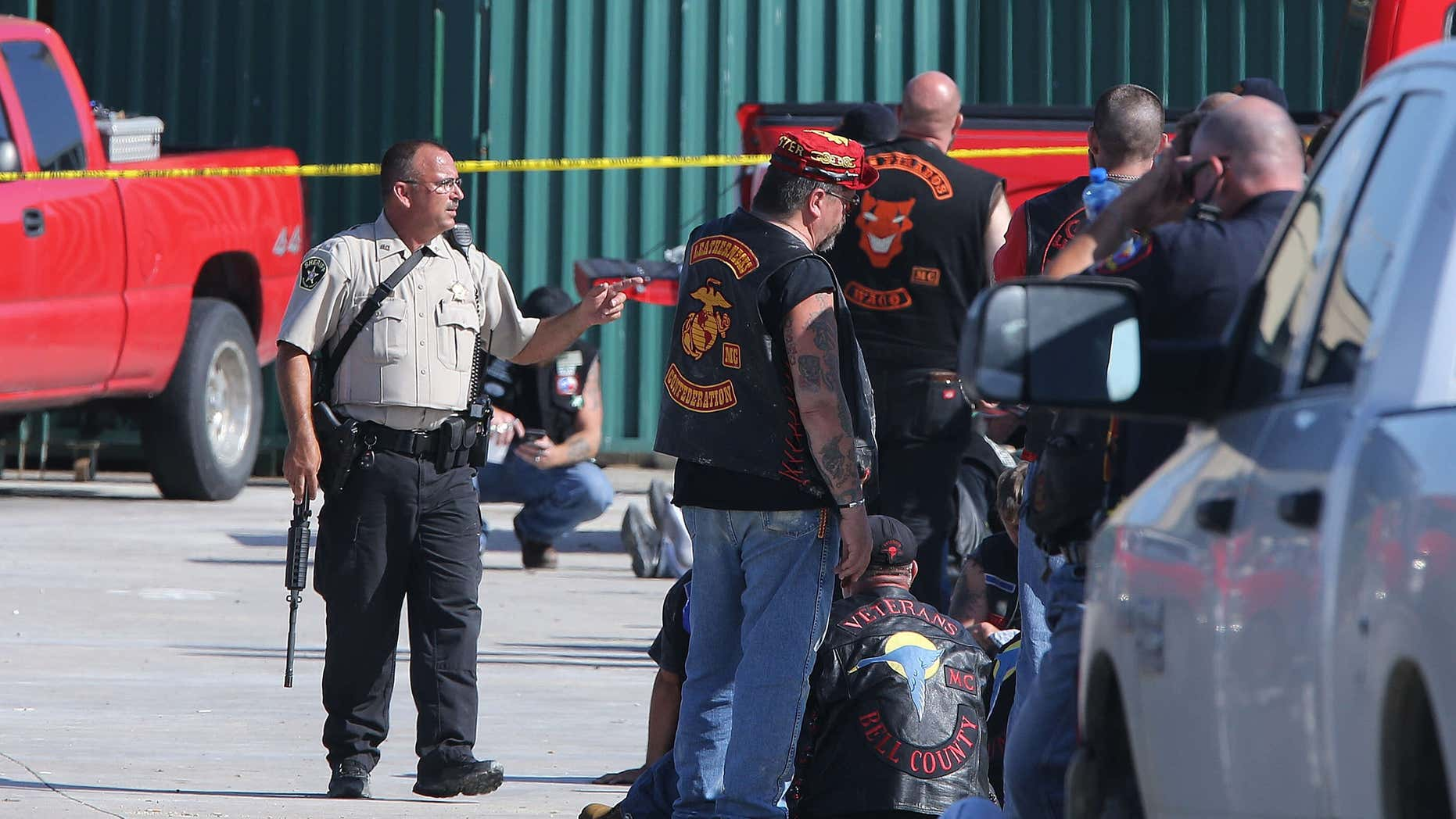 FILE - In this May 17, 2015, file photo, authorities investigate a shooting in the parking lot of the Twin Peaks restaurant in Waco, Texas.