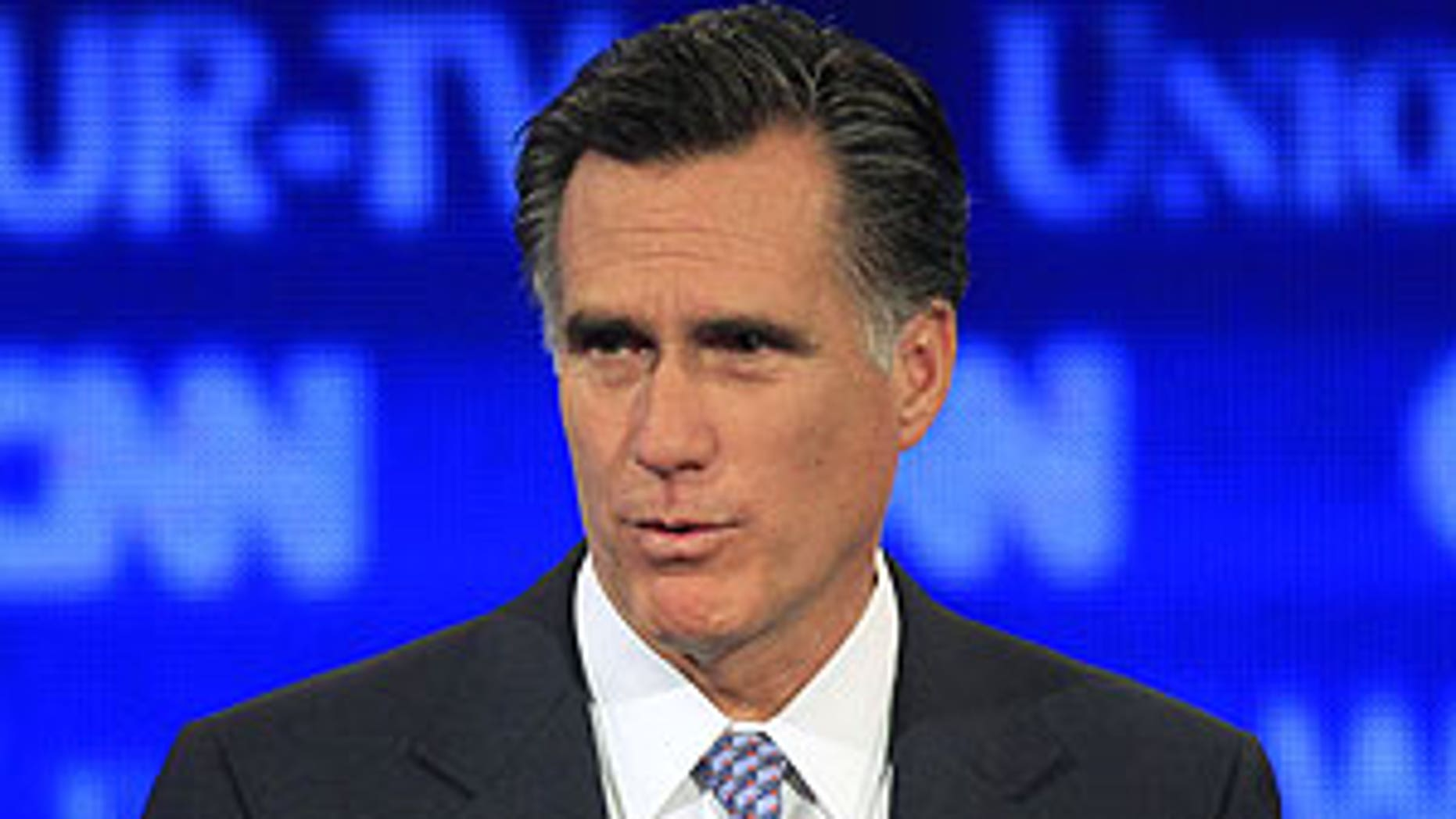 June 13: Former Massachusetts Gov. Mitt Romney answers a question during the first New Hampshire Republican presidential debate at St. Anselm College in Manchester, N.H.