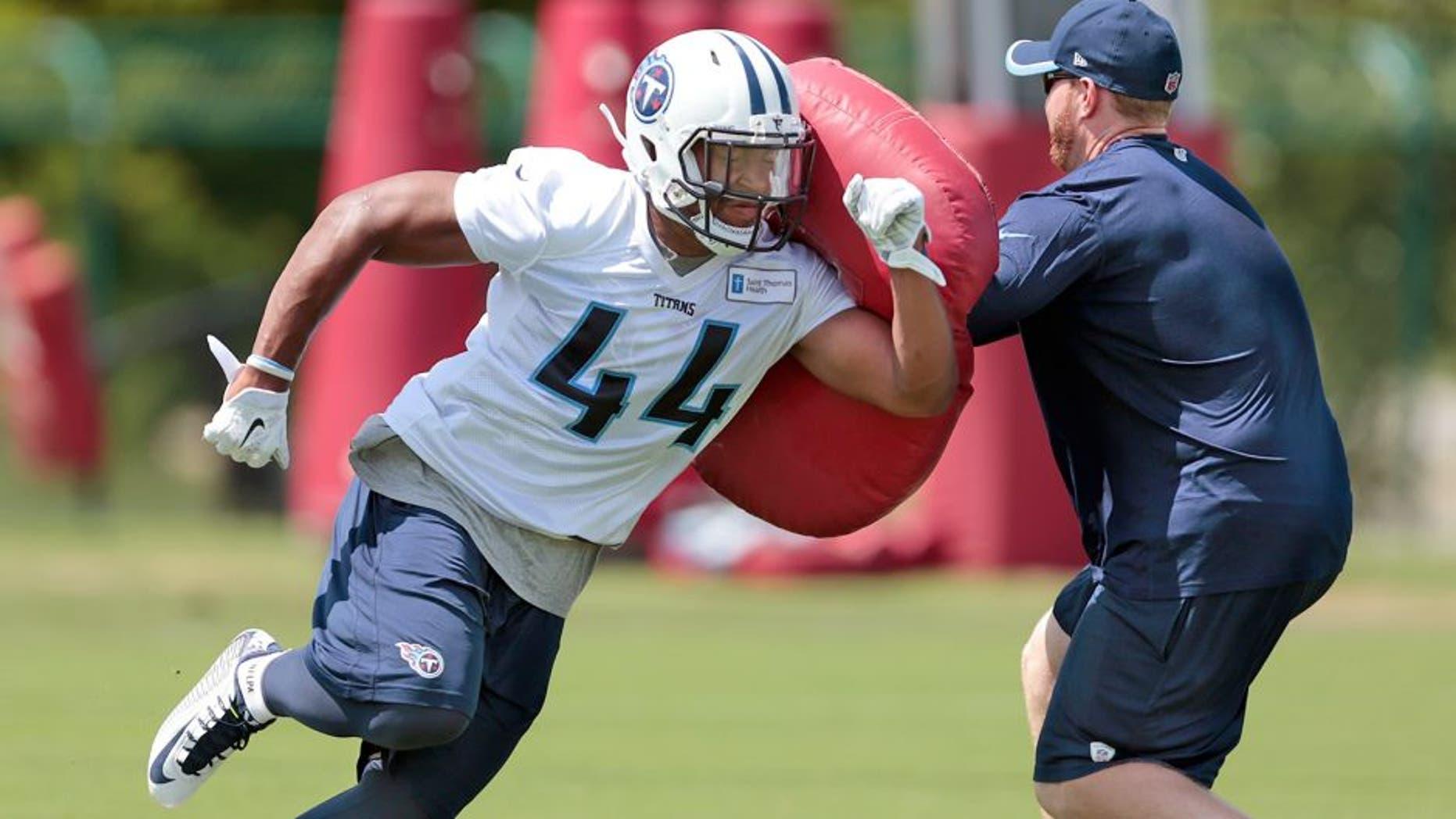 Tennessee Titans running back David Cobb (44) runs a drill during NFL football minicamp on Tuesday, June 16, 2015, in Nashville, Tenn. (AP Photo/Mark Humphrey)