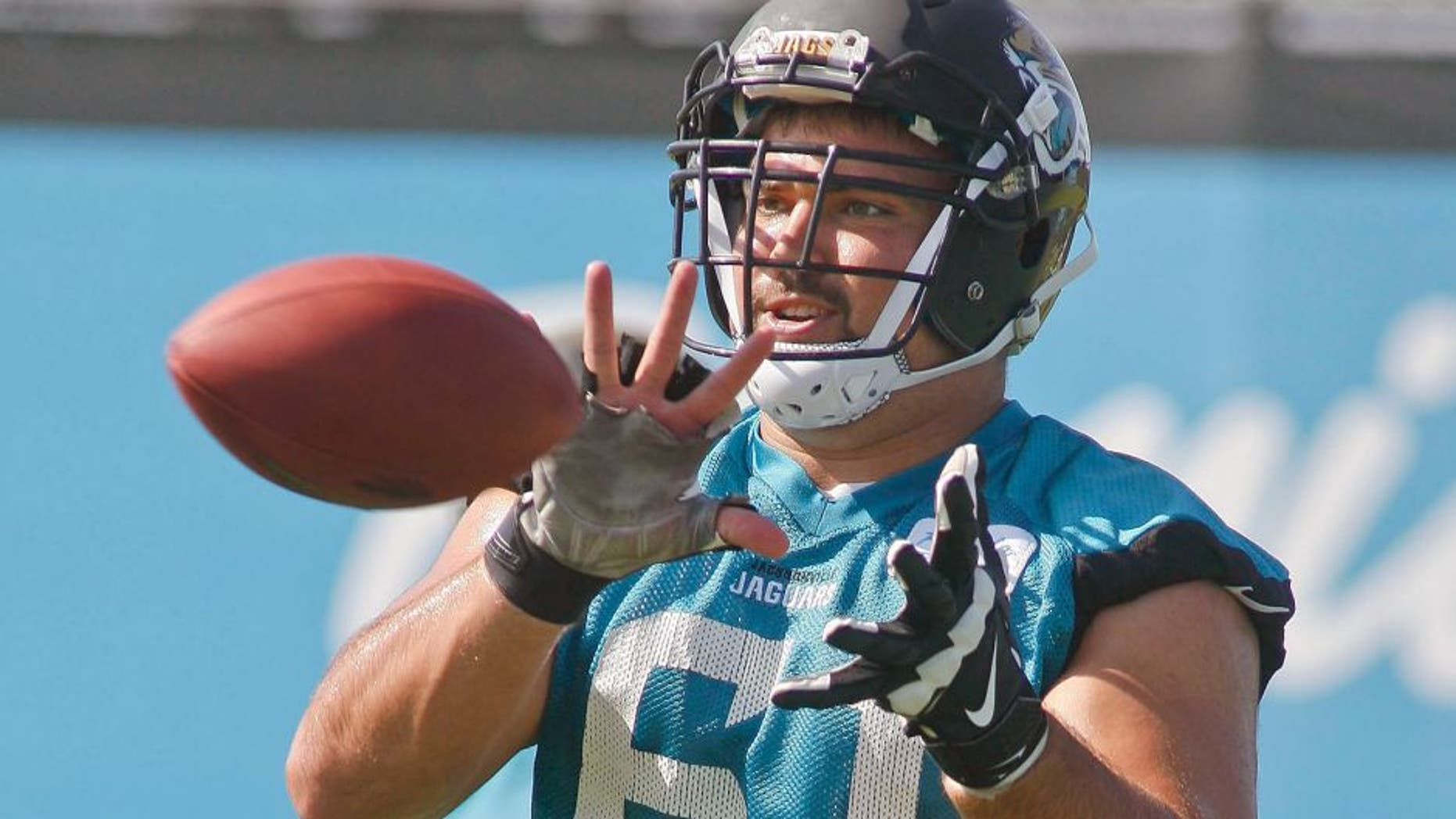 Jun 16, 2015; Jacksonville, FL, USA; Jacksonville Jaguars center Stefen Wisniewski (61) catches the ball during minicamp at the Florida Blue Health and Wellness Practice Fields. Mandatory Credit: Phil Sears-USA TODAY Sports