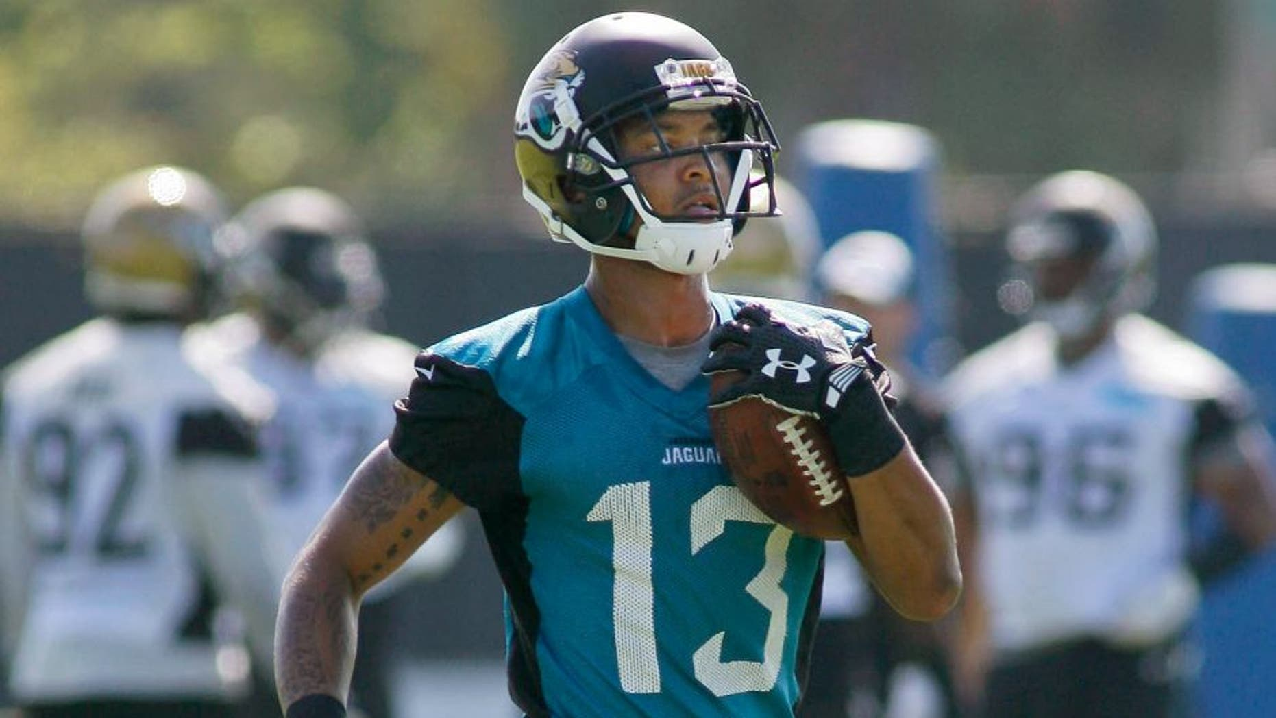 Jun 16, 2015; Jacksonville, FL, USA; Jacksonville Jaguars wide receiver Rashad Greene (13) returns a punt during minicamp at the Florida Blue Health and Wellness Practice Fields. Mandatory Credit: Phil Sears-USA TODAY Sports