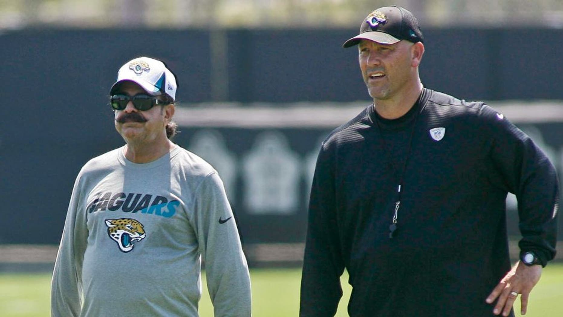 Jun 16, 2015; Jacksonville, FL, USA; Jacksonville Jaguars owner Shad Khan (left) and head coach Gus Bradley during minicamp at the Florida Blue Health and Wellness Practice Fields. Mandatory Credit: Phil Sears-USA TODAY Sports