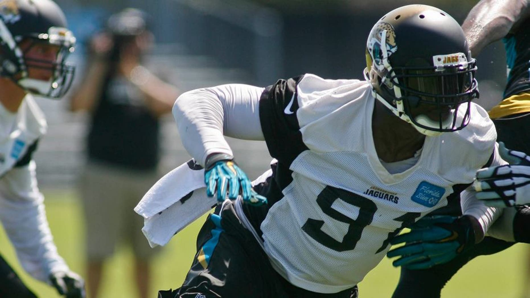 un 16, 2015; Jacksonville, FL, USA; Jacksonville Jaguars defensive end Chris Clemons (91) during minicamp at the Florida Blue Health and Wellness Practice Fields. Mandatory Credit: Phil Sears-USA TODAY Sports