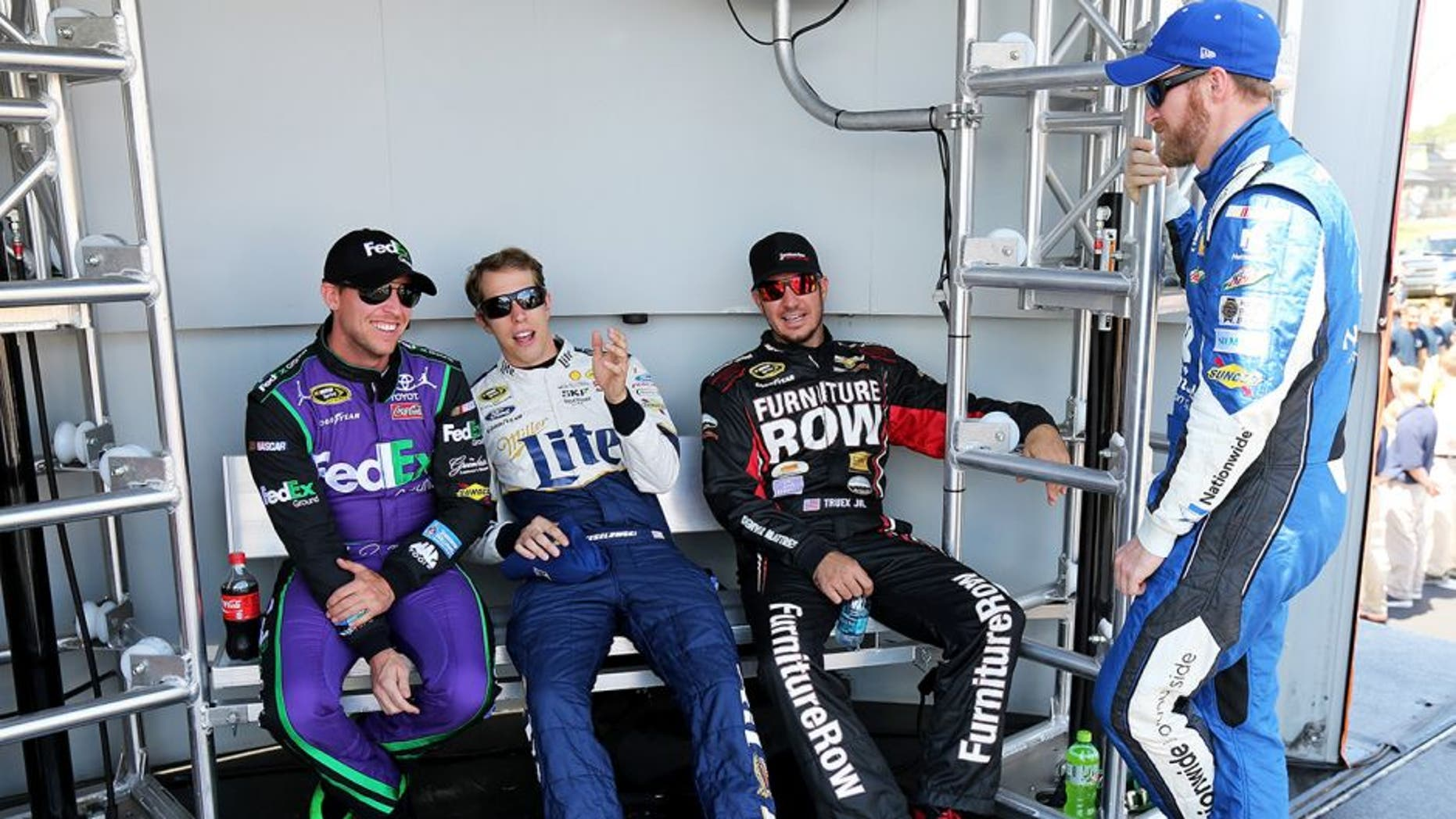 WATKINS GLEN, NY - AUGUST 09: (L-R) Denny Hamlin, driver of the #11 FedEx Ground Toyota, Brad Keselowski, driver of the #2 Miller Lite/Luke Bryan Ford, Martin Truex Jr., driver of the #78 Furniture Row/Visser Precision Chevrolet, and Dale Earnhardt Jr., driver of the #88 Nationwide Chevrolet, talk behind stage prior to the NASCAR Sprint Cup Series Cheez-It 355 at the Glen at Watkins Glen International on August 9, 2015 in Watkins Glen, New York. (Photo by Jerry Markland/Getty Images)