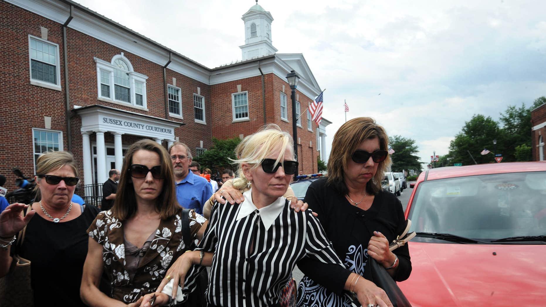 June 16, 2015: Ex-Baltimore Ravens cheerleader Molly Shattuck  leaves Delaware courthouse.