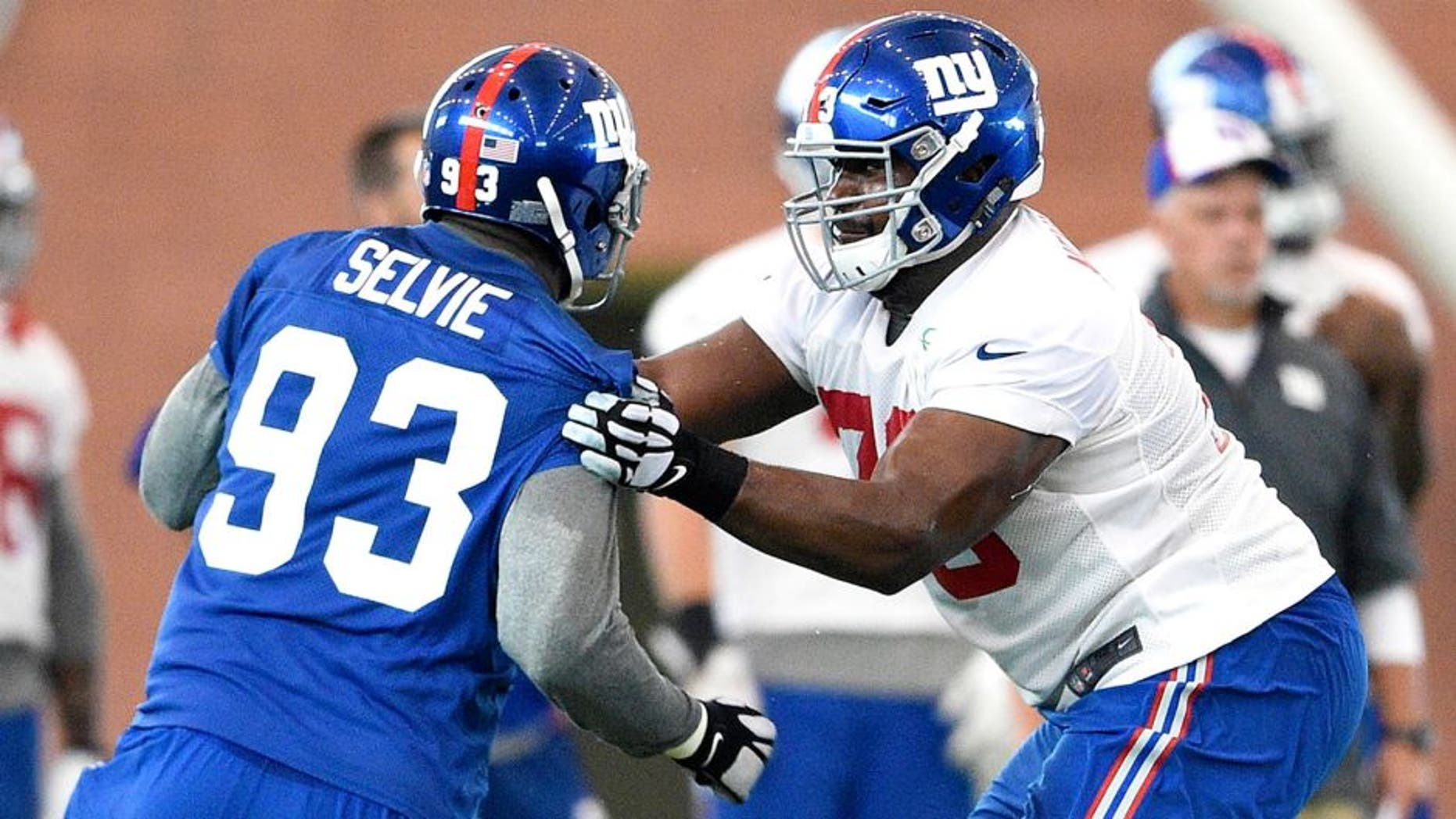 Jun 16, 2015; East Rutherford, NJ, USA; New York Giants tackle Marshall Newhouse (73) blocks defensive end George Selvie (93) during minicamp at Quest Diagnostics Training Center. Mandatory Credit: Steven Ryan-USA TODAY Sports