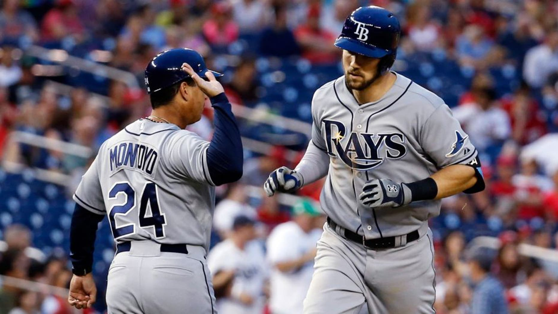 Tampa Bay Rays third base coach Charlie Montoyo (24) congratulates Steven Souza Jr. (20) as he rounds the bases on a solo home run during the fifth inning of a baseball game against the Washington Nationals at Nationals Park, Wednesday, June 17, 2015, in Washington. (AP Photo/Alex Brandon)