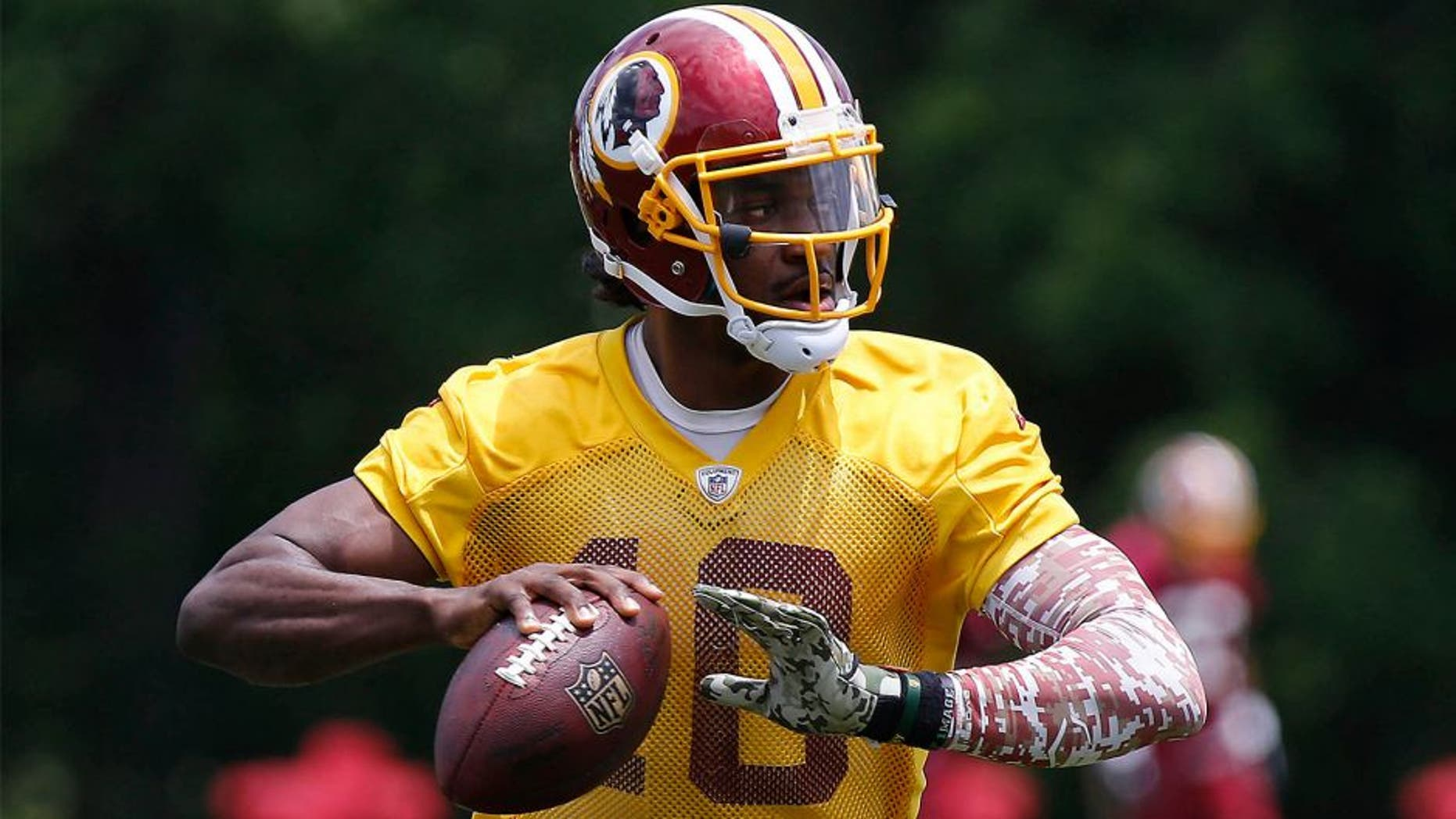 Jun 16, 2015; Ashburn, VA, USA; Washington Redskins quarterback Robert Griffin III (10) prepares to throw the ball during drills as part of day one of Redskins Minicamp at Redskins Park. Mandatory Credit: Geoff Burke-USA TODAY Sports