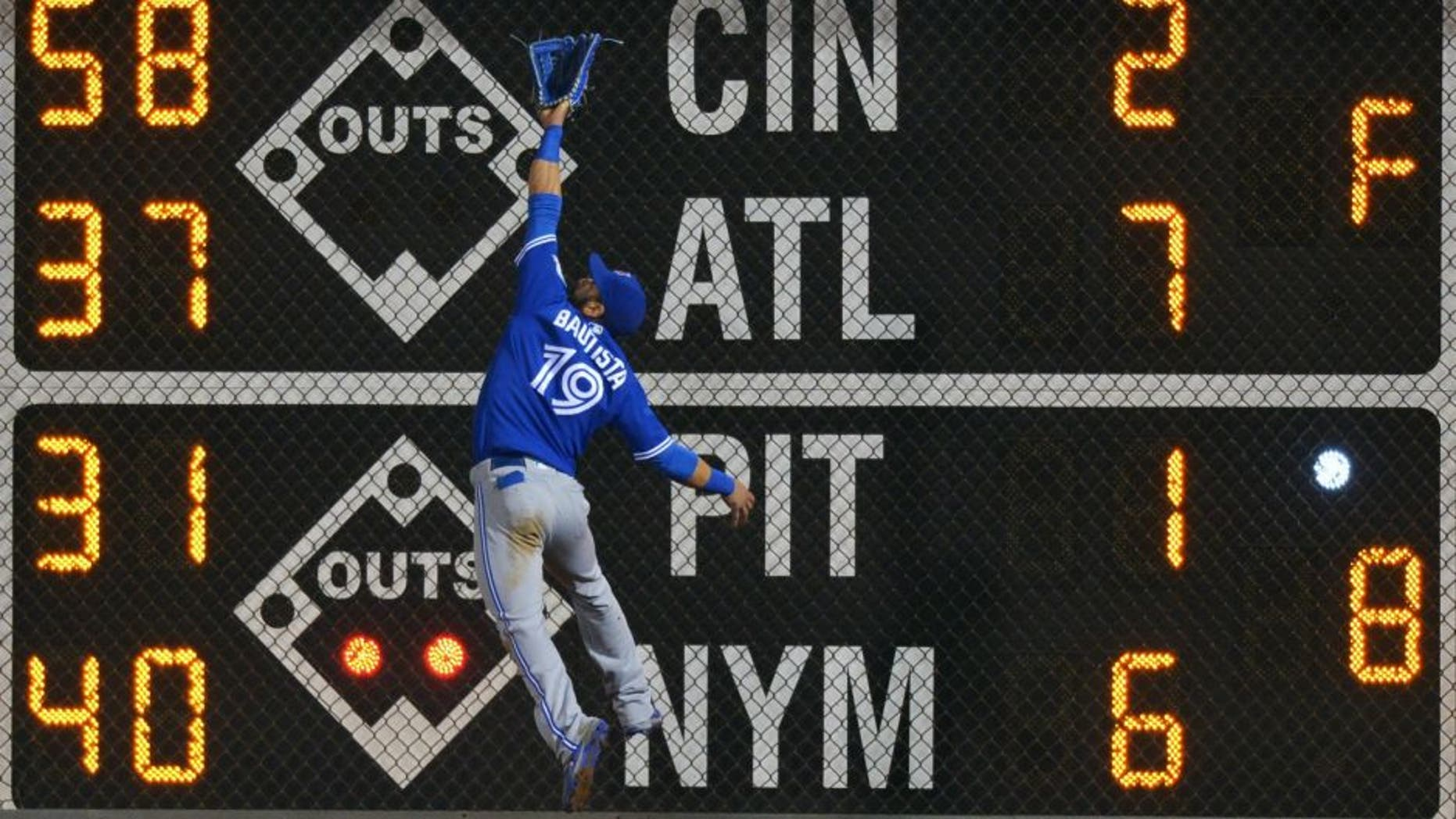 PHILADELPHIA, PA - JUNE 16: Jose Bautista #19 of the Toronto Blue Jays jumps for a fly ball but is unable to make the catch in the seventh inning against the Philadelphia Phillies at Citizens Bank Park on June 16, 2016 in Philadelphia, Pennsylvania. Bautista was injured on the play. (Photo by Drew Hallowell/Getty Images)