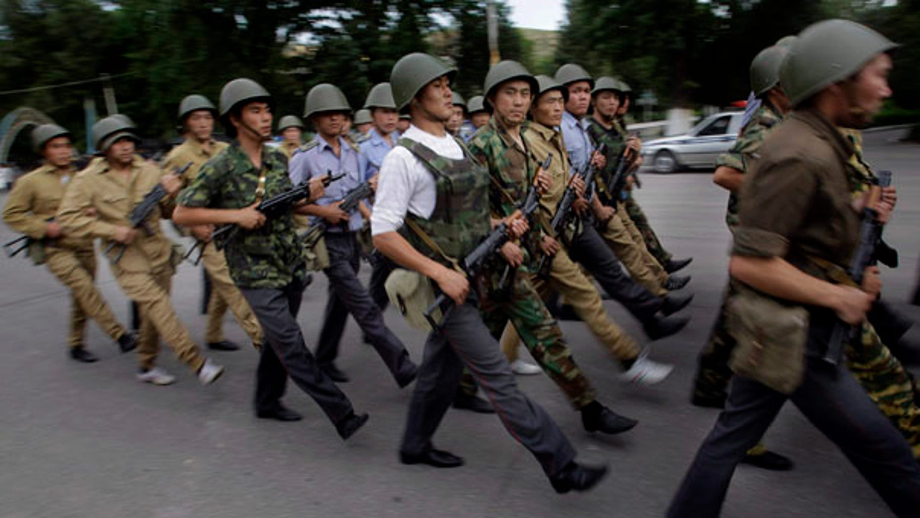 June 17: Kyrgyz police march during the evening guard in the southern Kyrgyz city of Jalal-Abad, Kyrgyzstan.