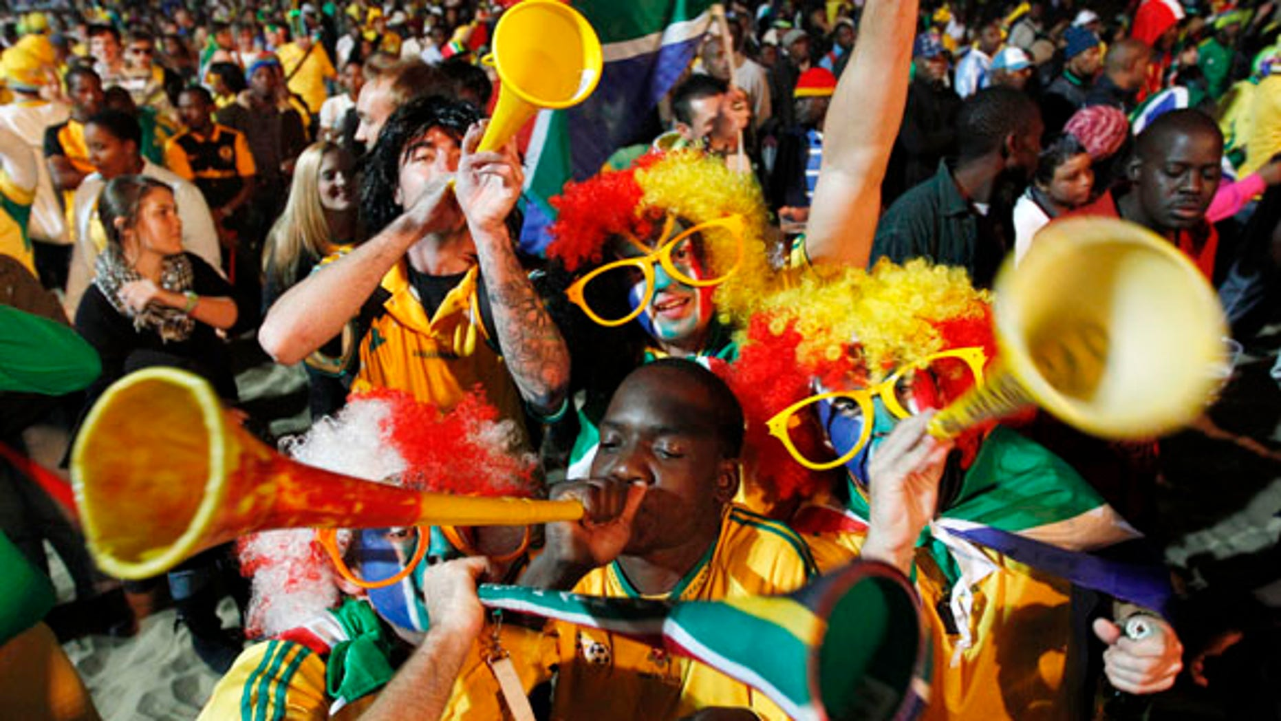 June 16: South African fans blow their vuvuzelas as they cheers at a beach in Durban, South Africa prior to the World Cup soccer match between South Africa and Uruguay.