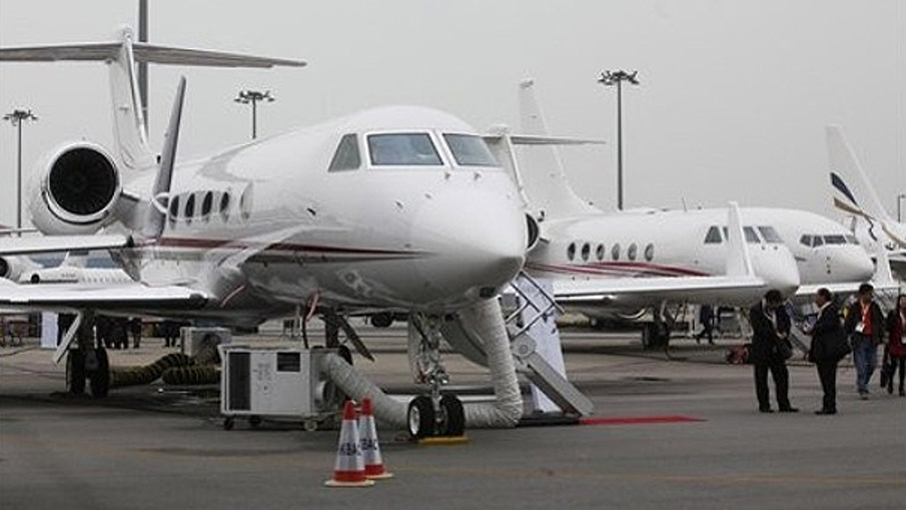 March 8: A Gulfstream G450 business jet, left, is displayed during the Asian Aerospace Show in Hong Kong .