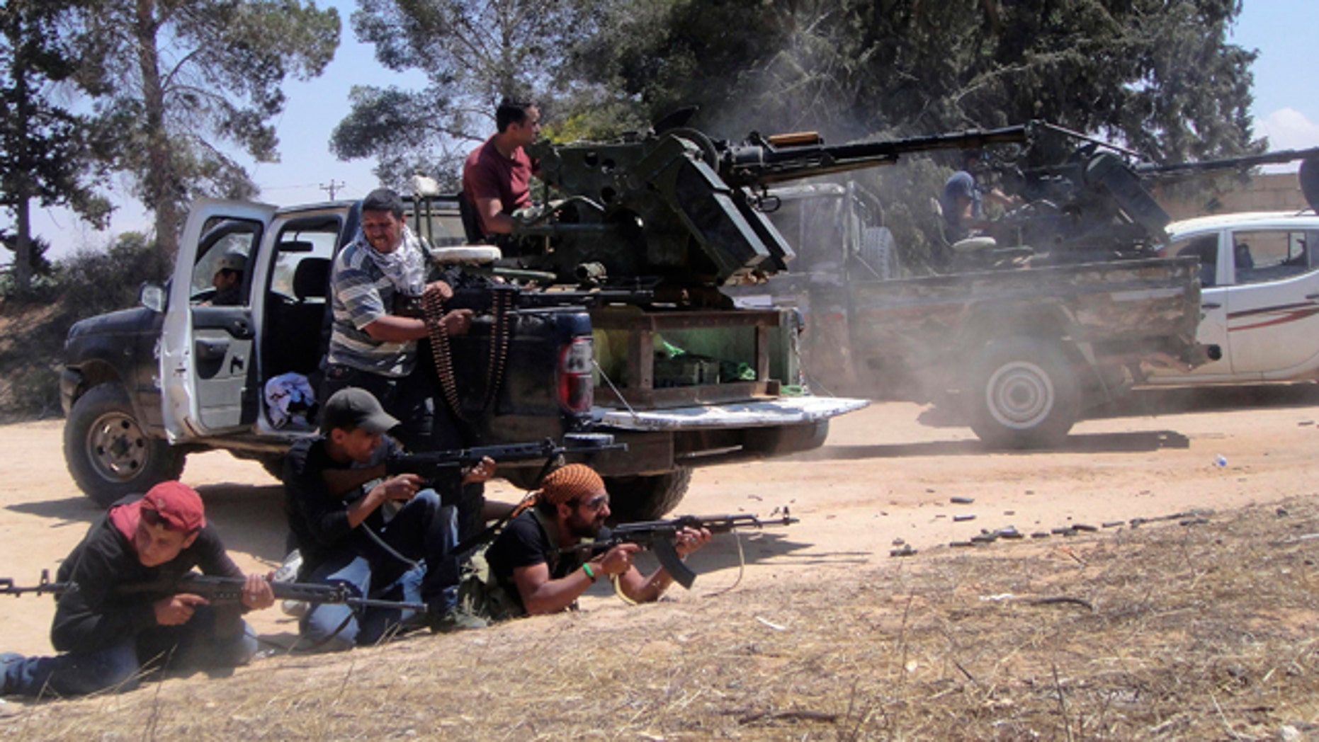 June 17: Rebel fighters fire their machine gun towards pro-Qaddafi forces on the front line of Dafniya in Misrata, Libya.