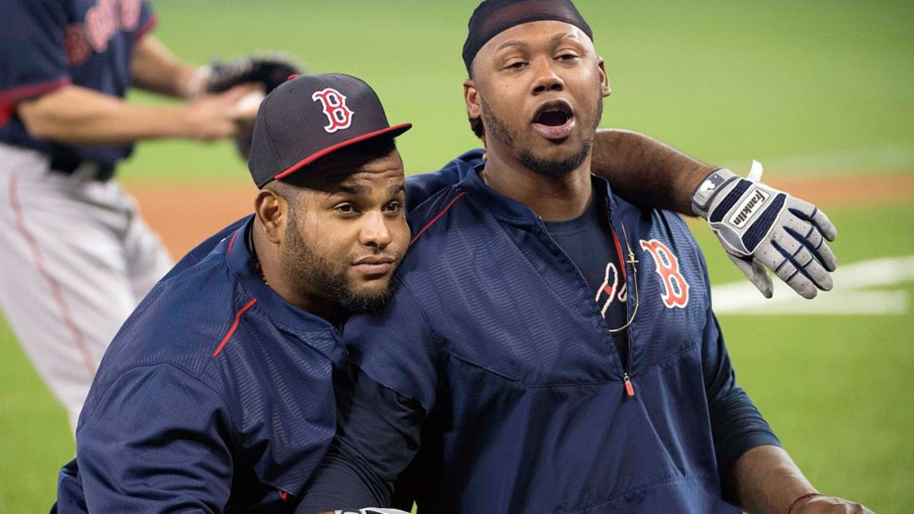 May 9, 2015; Toronto, Ontario, CAN; Boston Red Sox third baseman Pablo Sandoval (48) and Boston Red Sox left fielder Hanley Ramirez (13) during batting practice before a game against the Toronto Blue Jays at Rogers Centre. Mandatory Credit: Nick Turchiaro-USA TODAY Sports