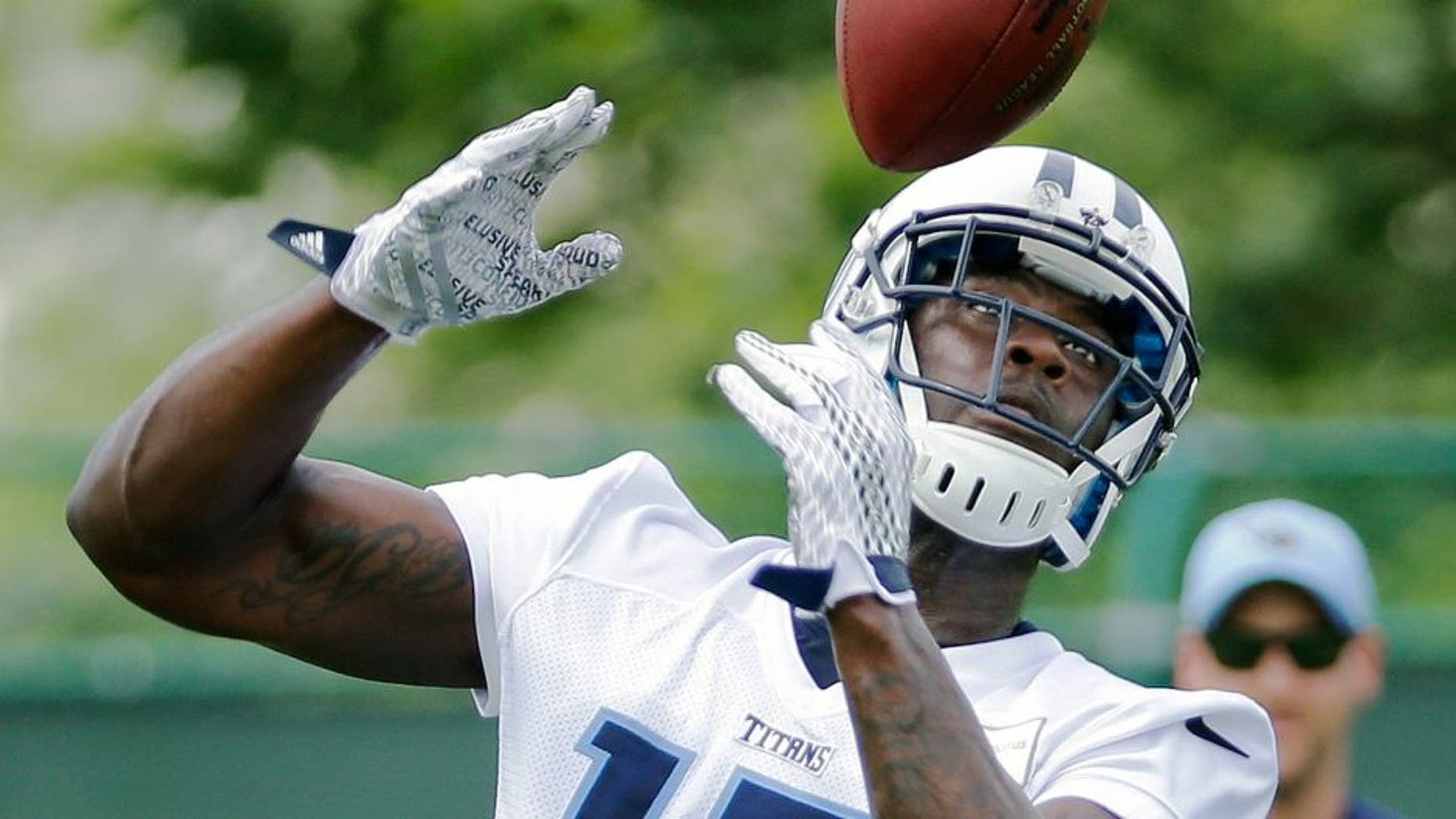 Tennessee Titans wide receiver Dorial Green-Beckham (17) catches a pass during NFL football minicamp on Thursday, June 18, 2015, in Nashville, Tenn. The Titans wrap up their three-day mandatory minicamp Thursday. (AP Photo/Mark Humphrey)
