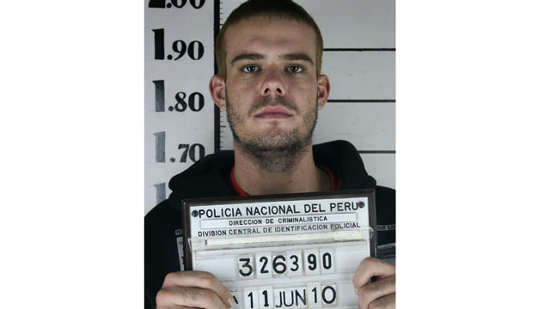 June 11: Dutch citizen Joran van der Sloot holds his inmate number before been transferred to the Miguel Castro Castro prison in Lima.