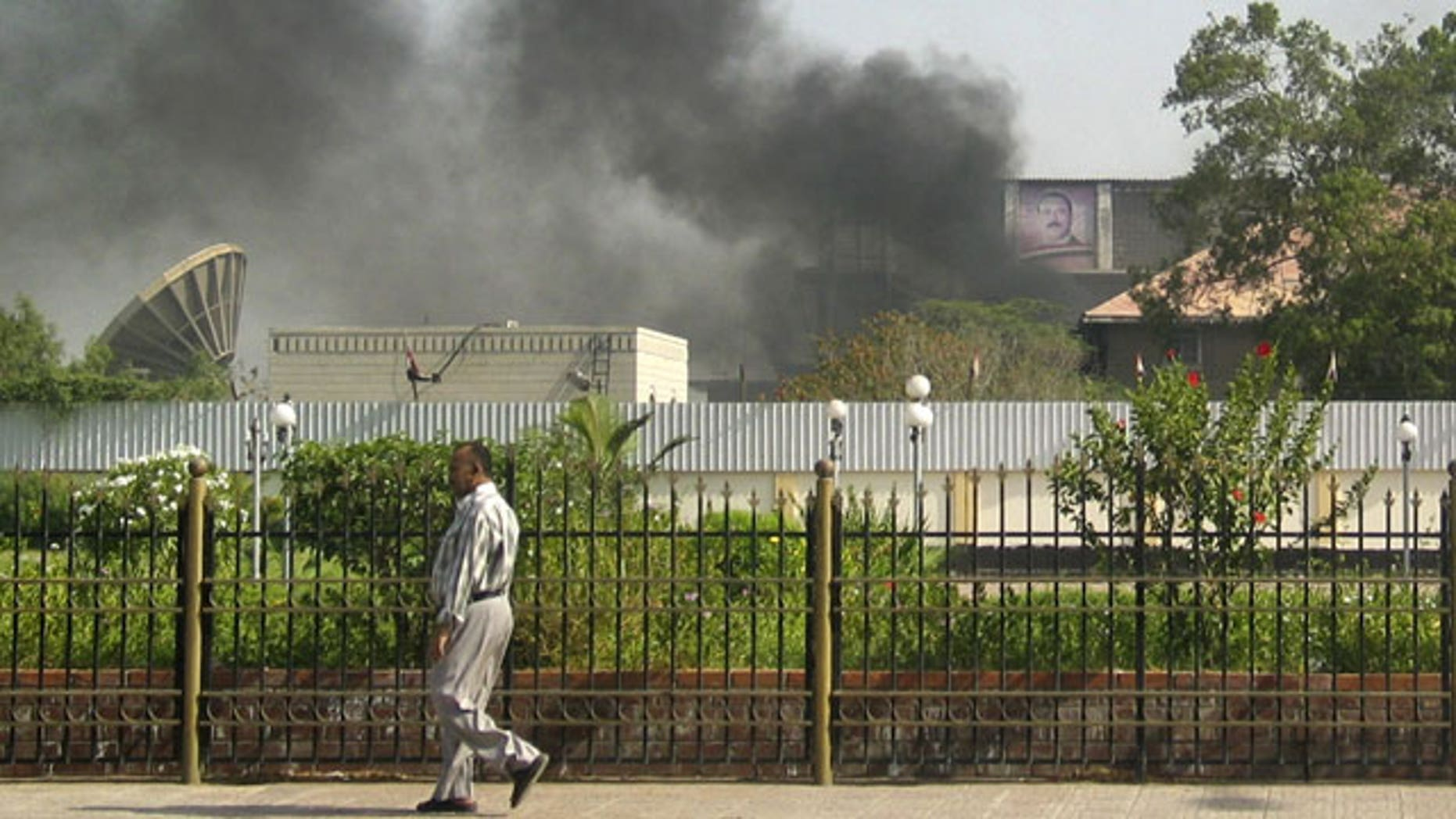 June 19: Black smoke is seen coming from the intelligence services building that came under attack in the southern port city of Aden, about 200 miles south of the capital, San'a, in Yemen.