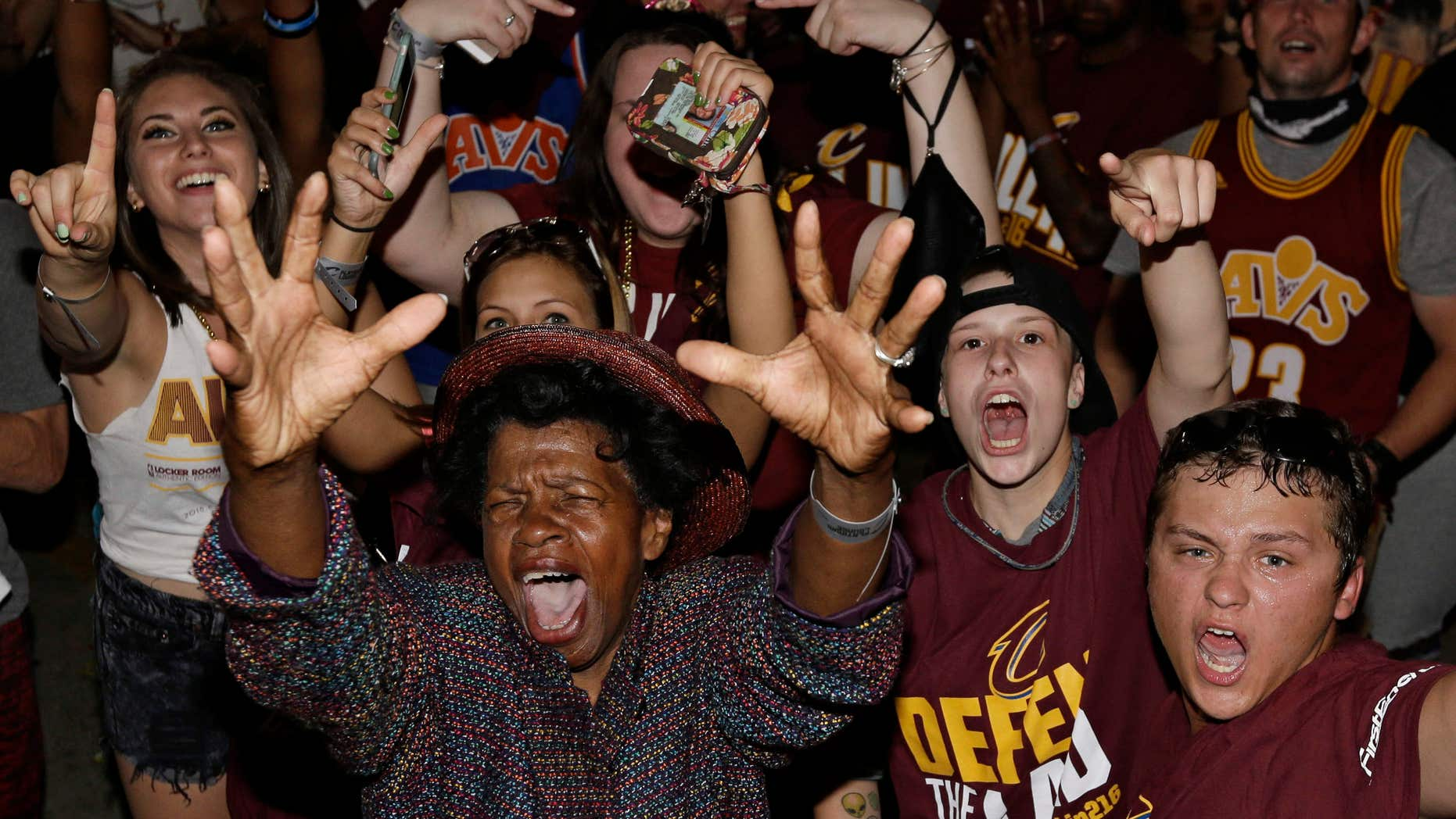 Cleveland Cavaliers fans celebrate after the Cavaliers defeated the Golden State Warriors 93-89 in Game 7 of the NBA basketball Finals, Sunday, June 19, 2016, in Cleveland.