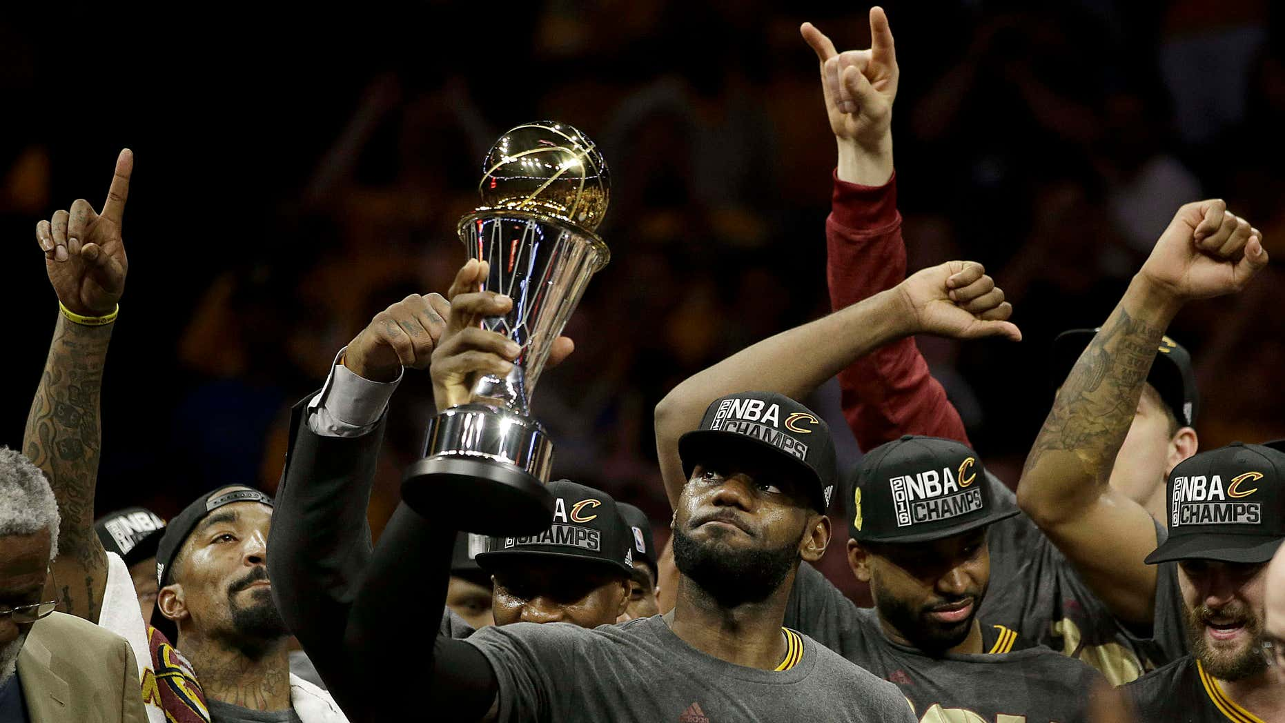 June 19, 2016: Cleveland Cavaliers forward LeBron James, center, celebrates with teammates after Game 7 of basketball's NBA Finals against the Golden State Warriors in Oakland, Calif.