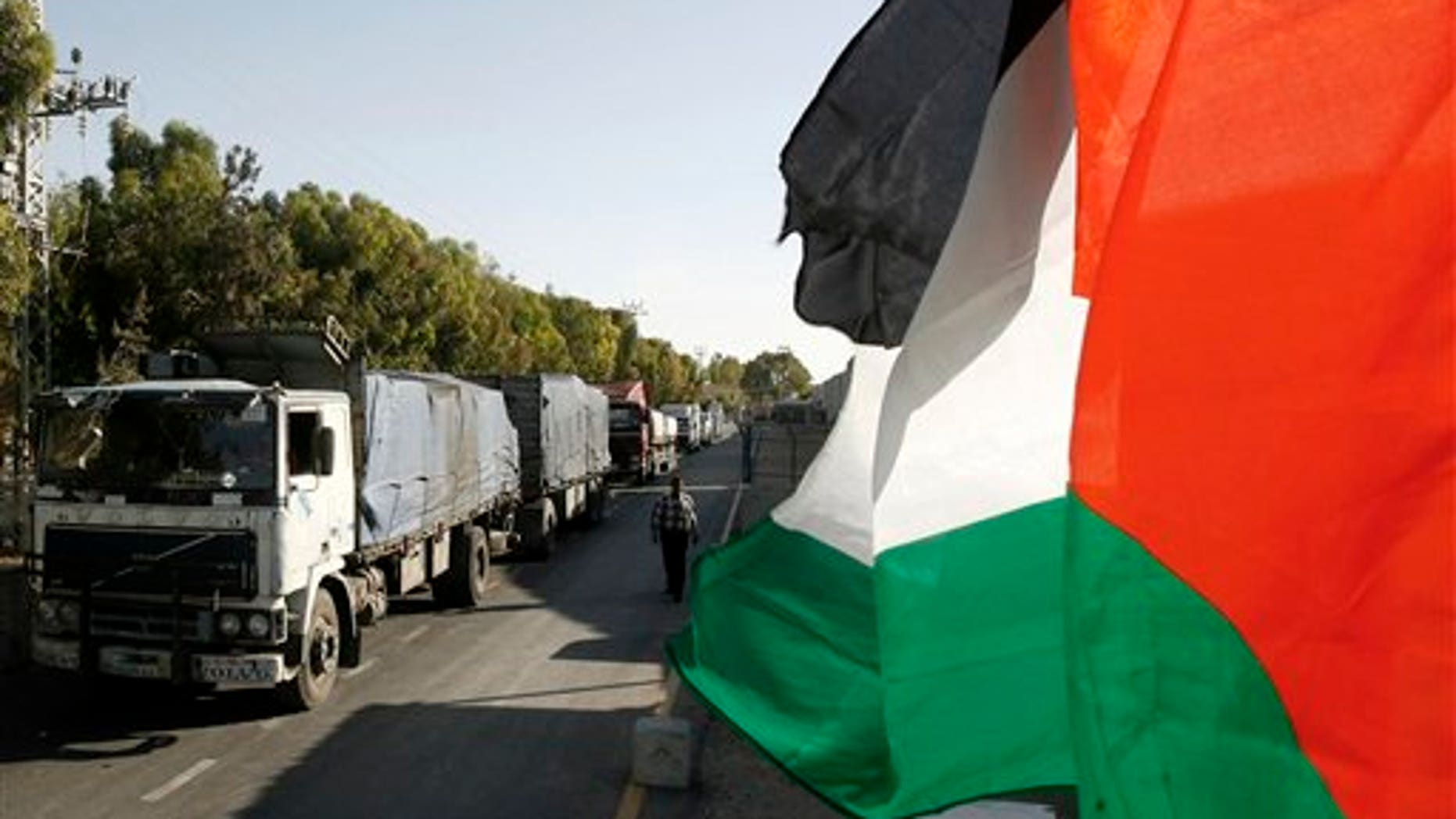 June 10: Palestinian trucks loaded with fruits and other goods arrive in Rafah from Israel through the Kerem Shalom border crossing between Israel and the Gaza Strip.