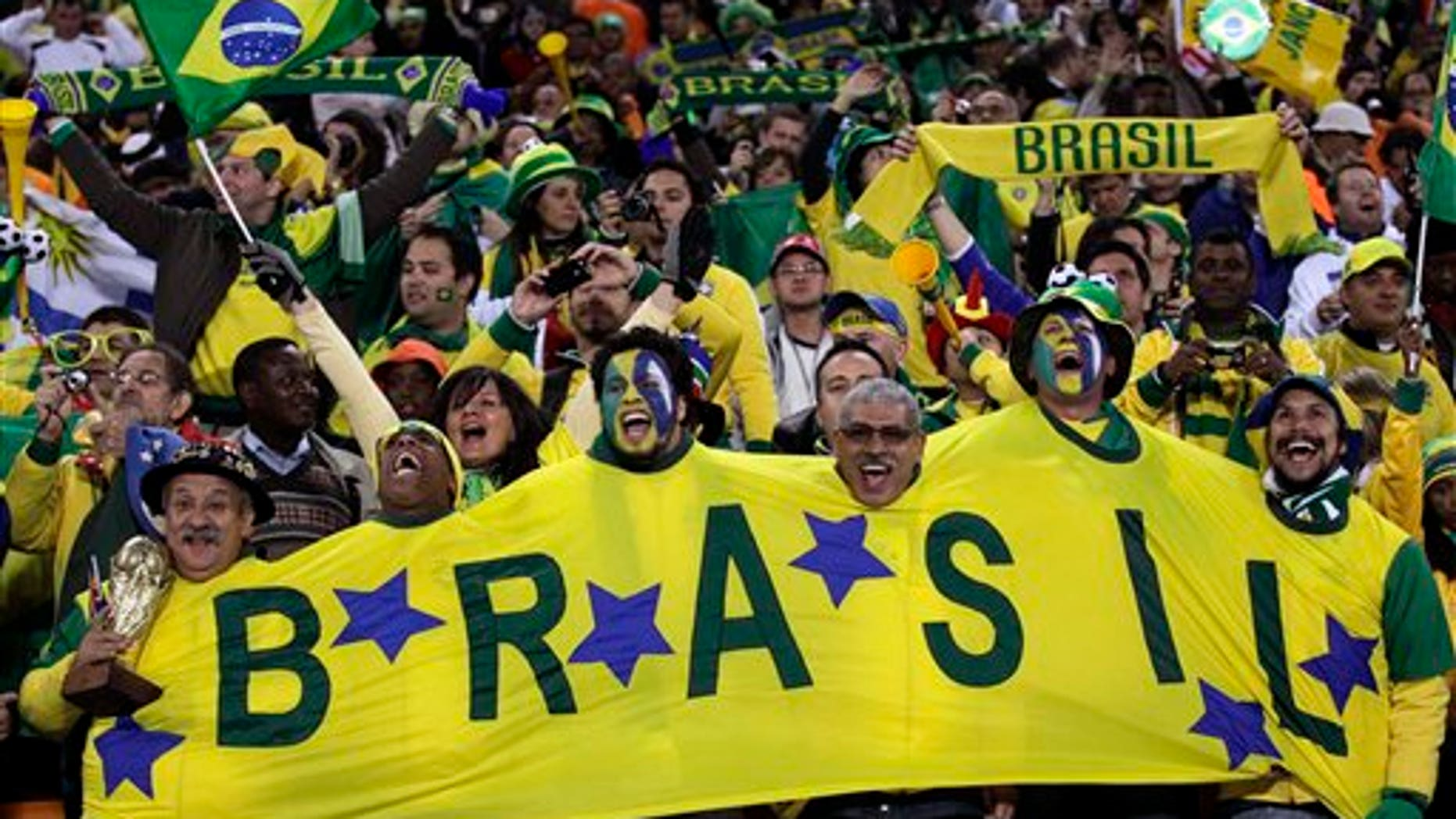 Brazil fans cheers prior to the World Cup group G soccer match between Brazil and Ivory Coast at Soccer City in Johannesburg, South Africa, Sunday, June 20, 2010.  (AP Photo/Frank Augstein)