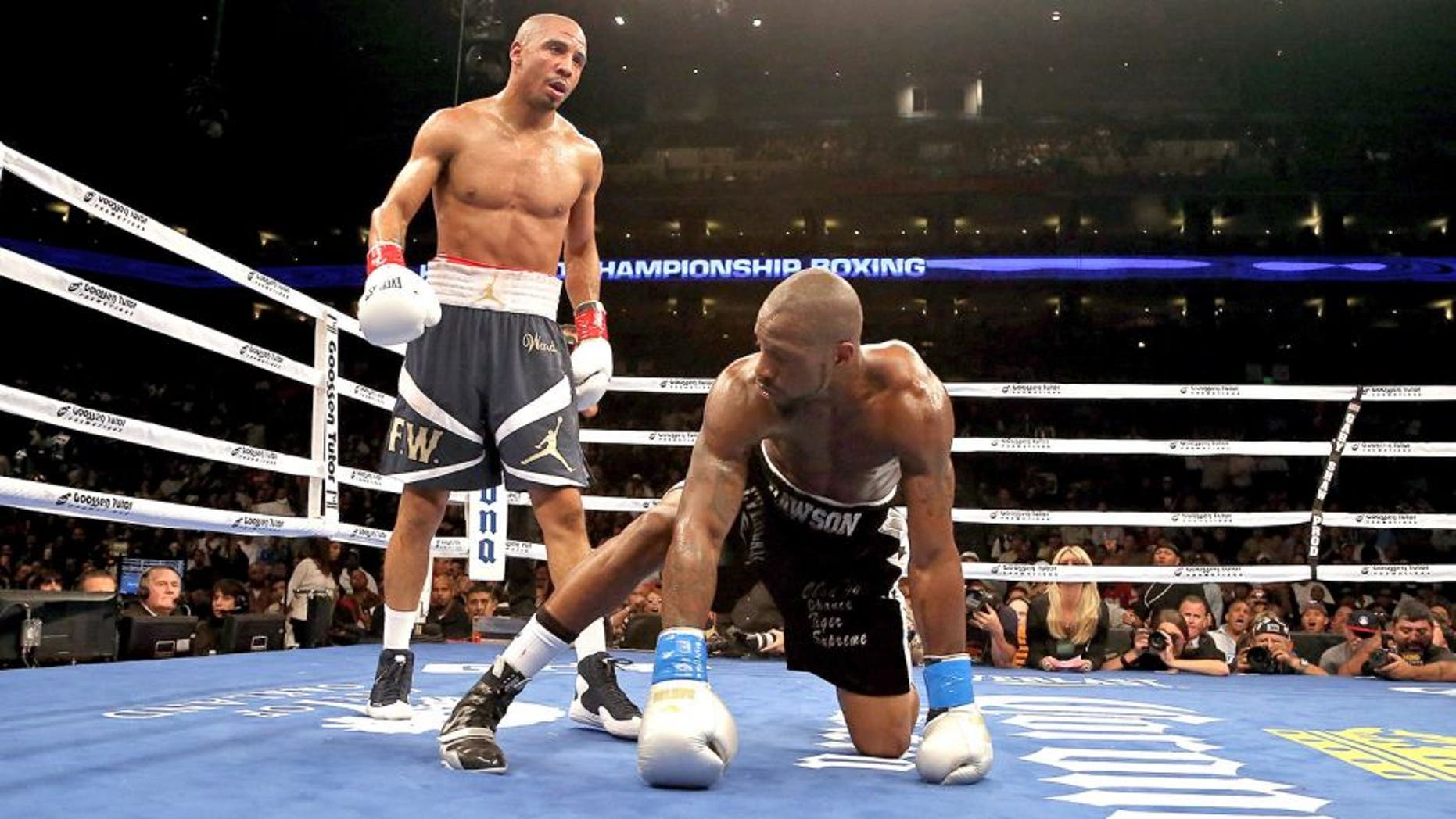 OAKLAND, CA - SEPTEMBER 08: Andre Ward (L) stands over Chad Dawson after he knocked him down in the third round of their WBA/WBC Super Middleweight championship fight at ORACLE Arena on September 8, 2012 in Oakland, California. Ward won by TKO in the 10th round. (Photo by Ezra Shaw/Getty Images)