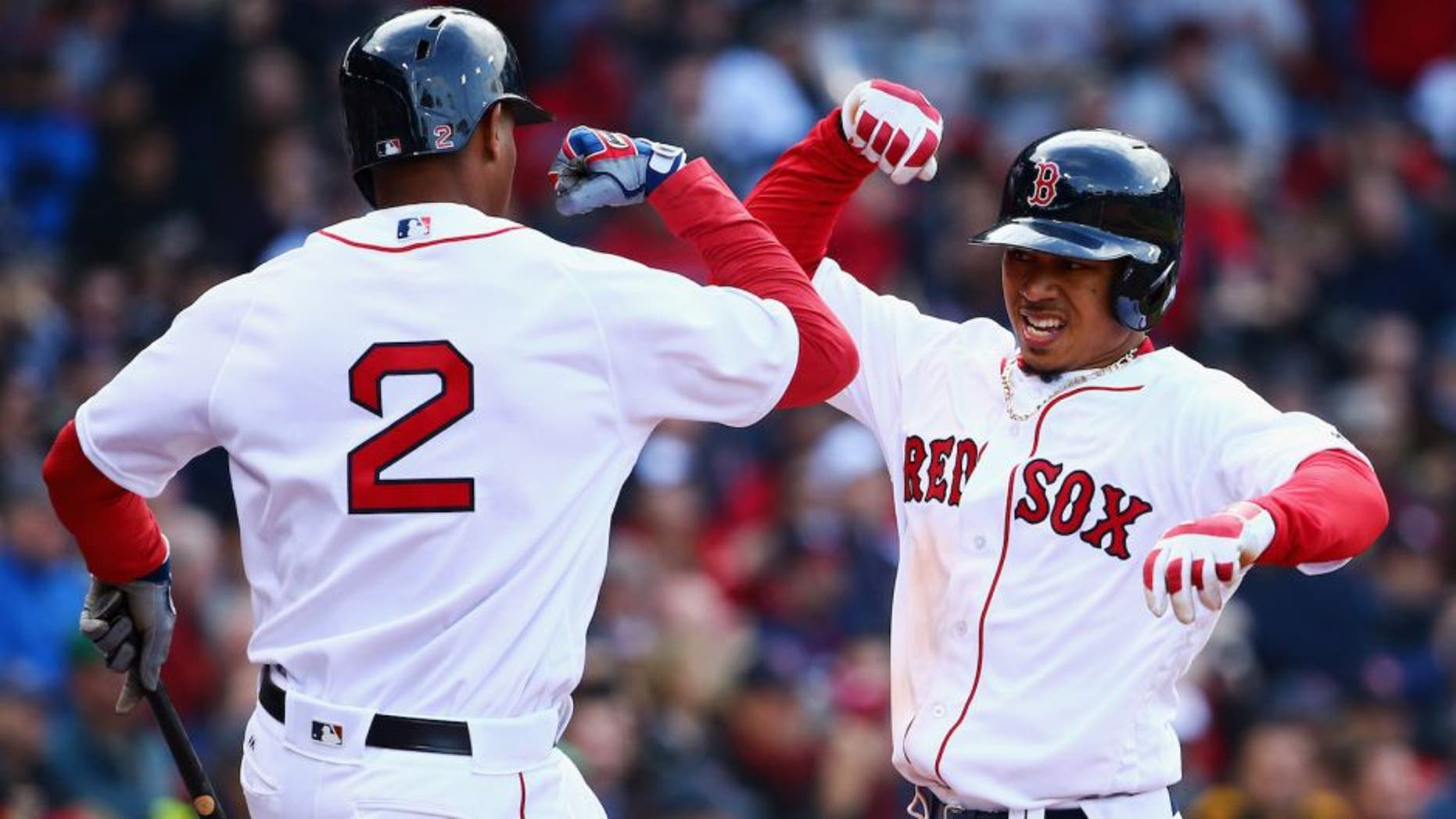 BOSTON, MASSACHUSETTS - APRIL 11: Mookie Betts #50 of the Boston Red Sox celebrates with Xander Bogaerts #2 of the Boston Red Sox after hitting a home run during the ninth inning of the Red Sox home opener at Fenway Park on April 11, 2016 in Boston, Massachusetts. The Orioles defeat the Red Sox 9-7. (Photo by Maddie Meyer/Getty Images)