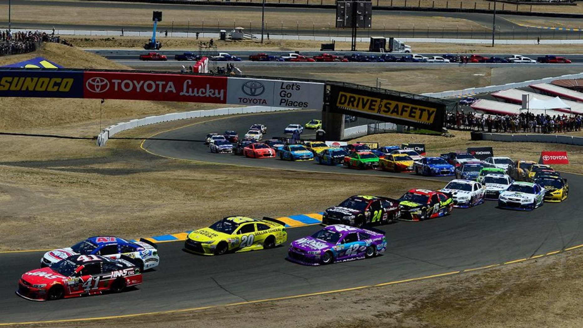 SONOMA, CA - JUNE 28: Kurt Busch, driver of the #41 Haas Automation Chevrolet, and AJ Allmendinger, driver of the #47 Kingsford Charcoal Chevrolet, lead the field at the start of the NASCAR Sprint Cup Series Toyota/Save Mart 350 at Sonoma Raceway on June 28, 2015 in Sonoma, California. (Photo by Robert Laberge/Getty Images)