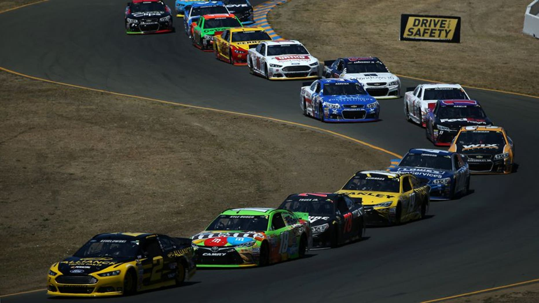 SONOMA, CA - JUNE 28: Brad Keselowski, driver of the #2 Alliance Truck Parts Ford, leads a pack of cars during the NASCAR Sprint Cup Series Toyota/Save Mart 350 at Sonoma Raceway on June 28, 2015 in Sonoma, California. (Photo by Patrick Smith/Getty Images)