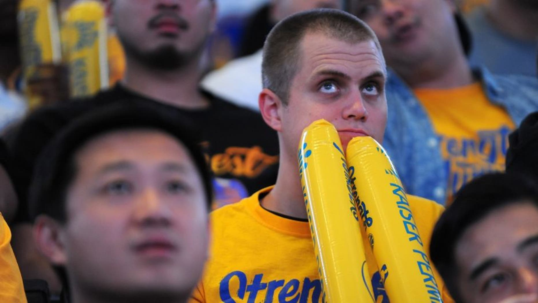 OAKLAND, CA - JUNE 16: A fan reacts in the final moments of Game Six during the Golden State Warriors NBA Finals watch party at ORACLE Arena on June 16, 2016 in Oakland, California. (Photo by Robert Reiners/Getty Images)
