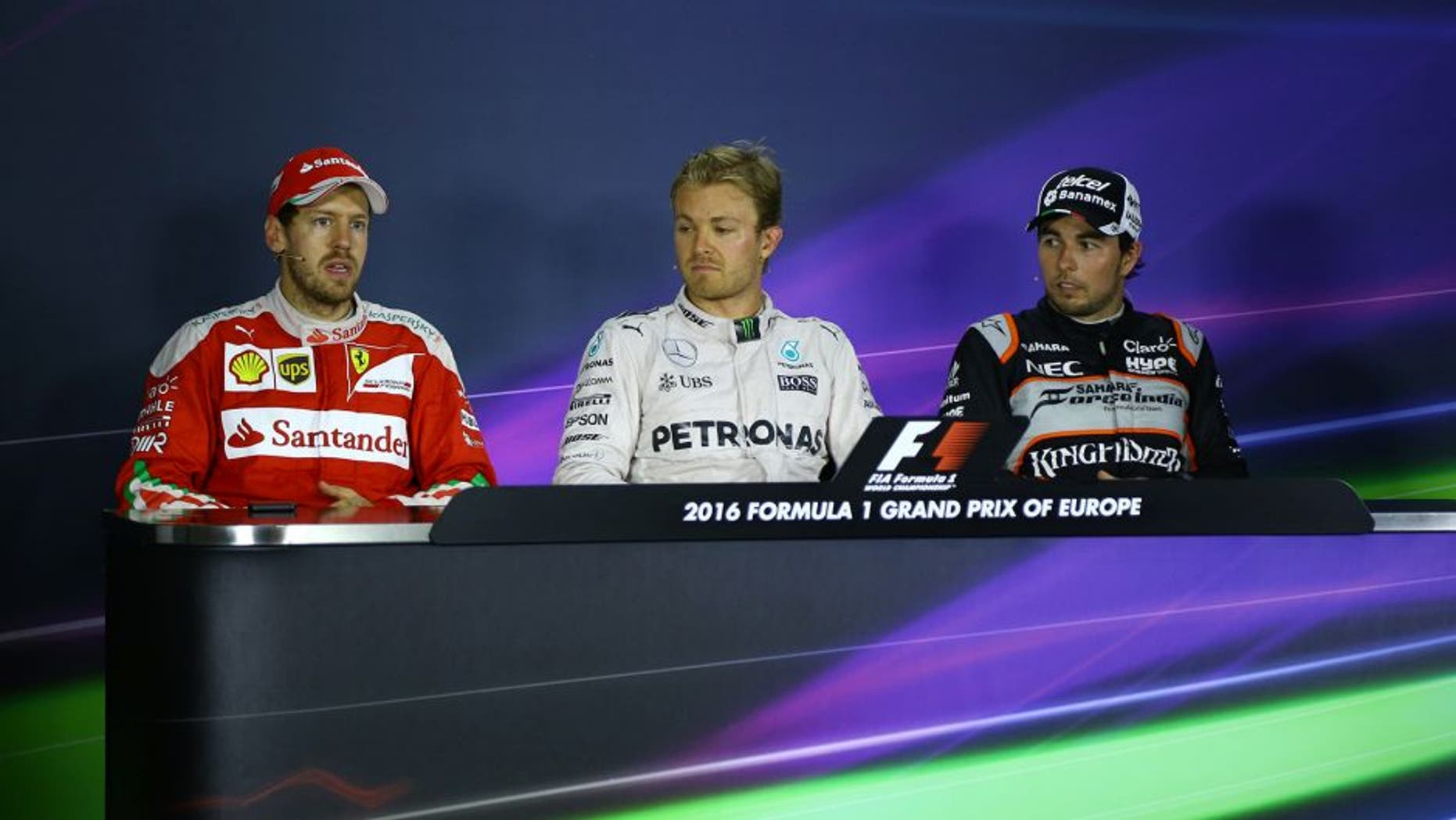 BAKU, AZERBAIJAN - JUNE 19: Nico Rosberg (C) of Mercedes AMG Pertronas F1 (C), Ferrari's Sebastian Vettel (L) and Sergio Perez (R) of Sahara Force India F1 attend a press conference during the 2016 Formula One Grand Prix of Europe in Baku, Azerbaijan on June 19, 2016. (Photo by Resul Rehimov/Anadolu Agency/Getty Images)