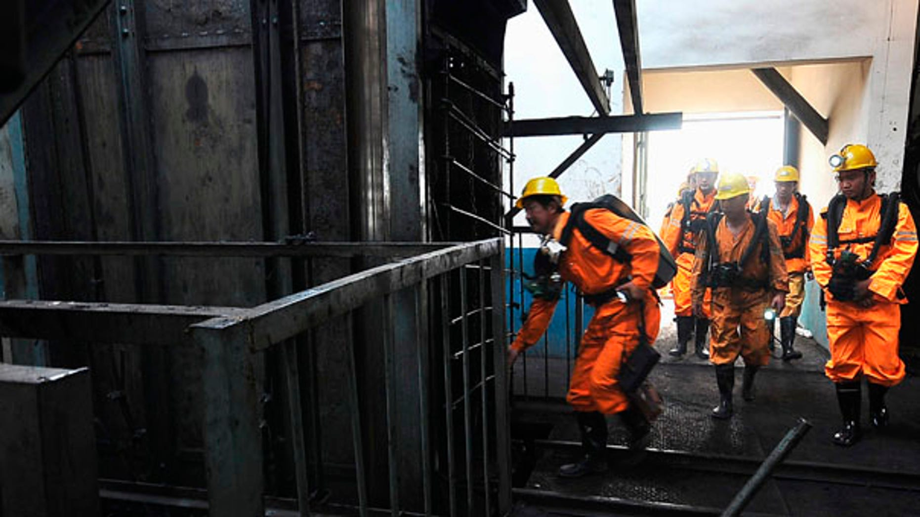 Rescue workers prepare to search for missing miners after a blast at the Xingdong No.2 Coal Mine in Pingdingshan city in central China's Henan province on Monday, June 21, 2010.   State media say at least 46 miners were killed when an explosion ripped through the coal mine. (AP Photo)**CHINA OUT**