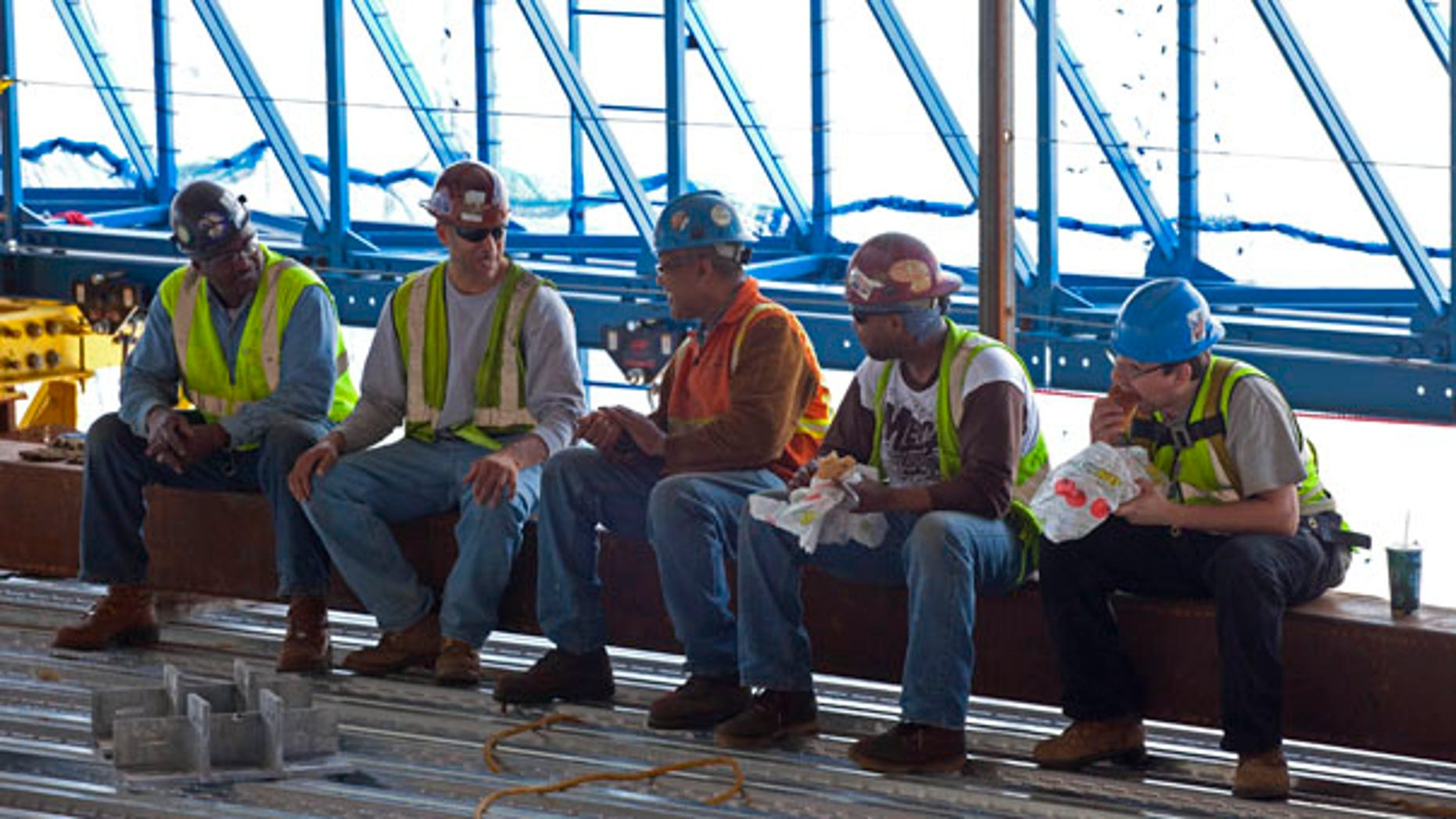 June 18: Construction workers take a lunch break inside the rising structure of One World Trade Center in New York. A Subway sandwich shop is serving workers atop the Ground Zero scaffolding that will become Freedom Tower. The eatery, built out of shipping containers, is rising along with the signature skyscraper with the help of a hydraulically powered platform.