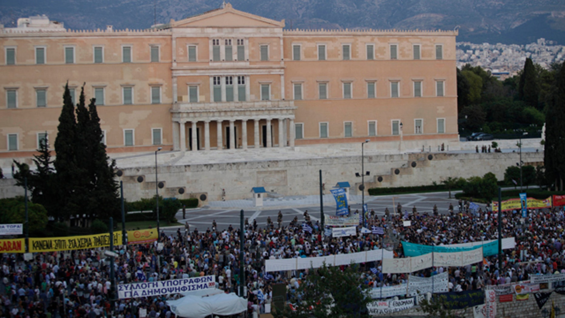 June 21: Greek protesters gather at Syntagma square in front of the Greek Parliament in central Athens, during a peaceful ongoing rally against plans for new austerity measures.