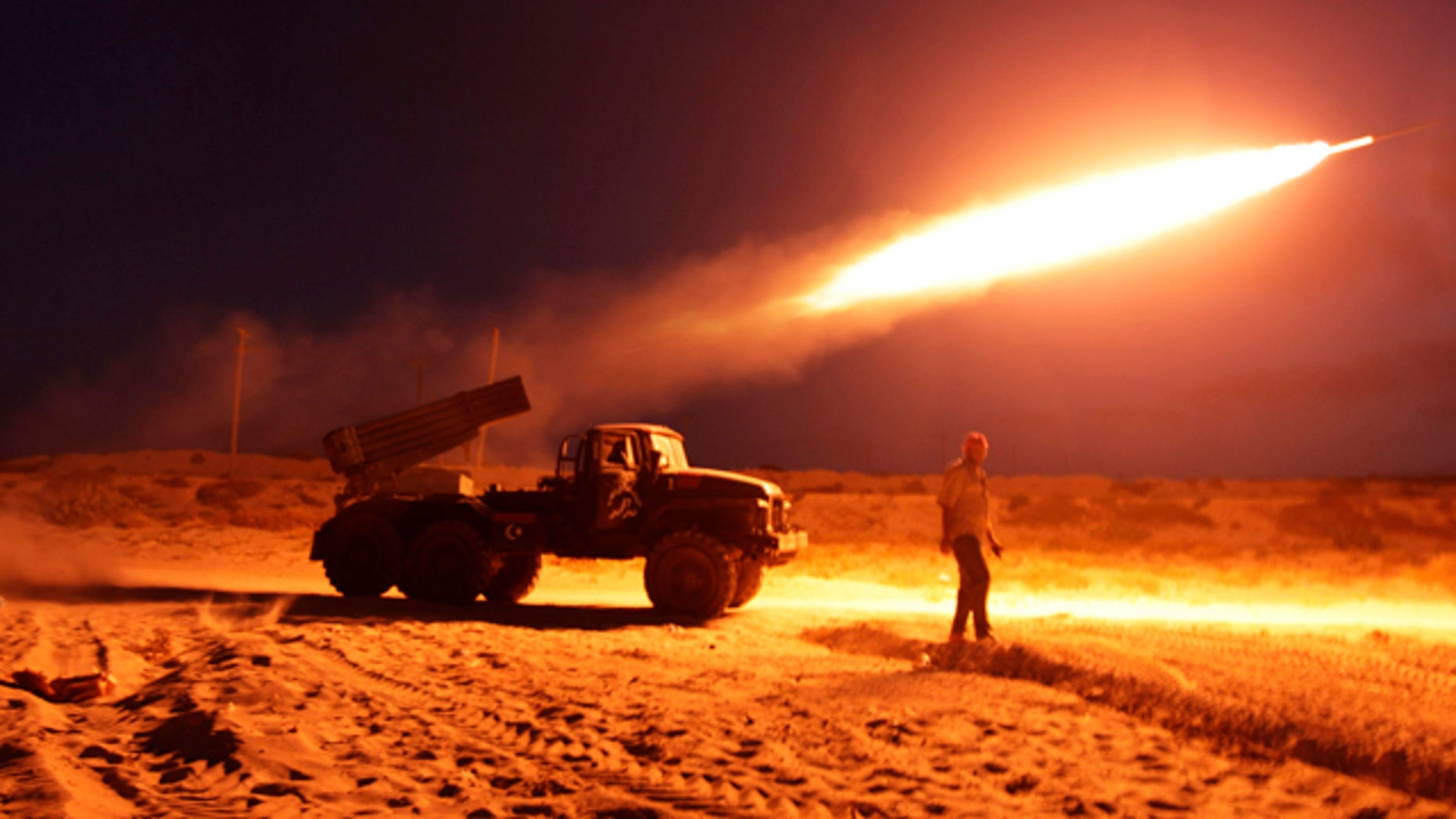 June 20: Rebel fighters fire a Grad rocket at the front line west of Misrata, Libya.
