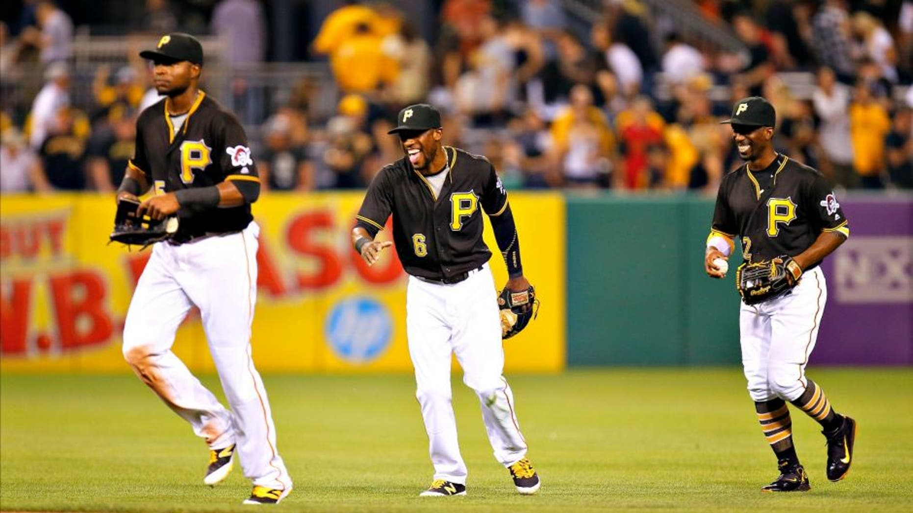 PITTSBURGH, PA - JUNE 20: Andrew McCutchen #22, Starling Marte #6 and Gregory Polanco #25 of the Pittsburgh Pirates celebrate after defeating the San Francisco Giants 1-0 at PNC Park on June 20, 2016 in Pittsburgh, Pennsylvania. (Photo by Justin K. Aller/Getty Images)