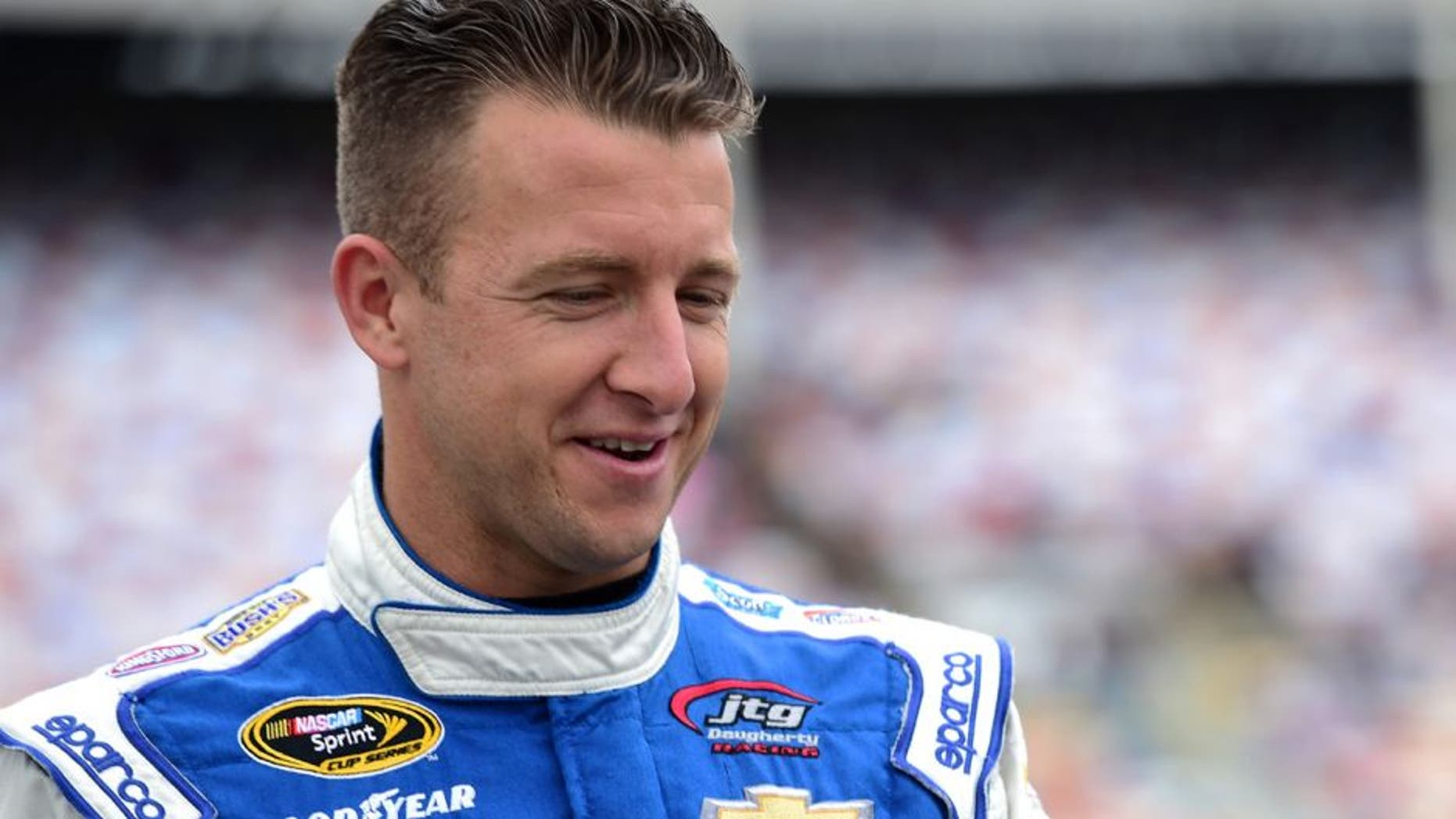 CHARLOTTE, NC - MAY 21: AJ Allmendinger, driver of the #47 Uwharrie Bank Chevrolet, walks on the grid during the NASCAR Sprint Cup Series Sprint Showdown at Charlotte Motor Speedway on May 21, 2016 in Charlotte, North Carolina. (Photo by Jared C. Tilton/Getty Images)