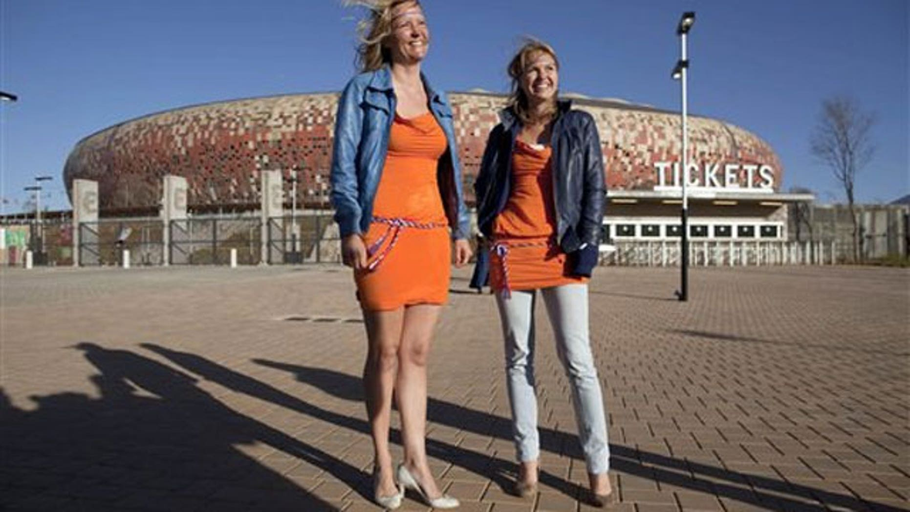 June 15: Barbara Castelein, left, and Mierte, both from the Netherlands, outside the Soccer City stadium in Johannesburg, where they were arrested for wearing orange mini-dresses that are the symbol of a beer advertising campaign in the Netherlands.