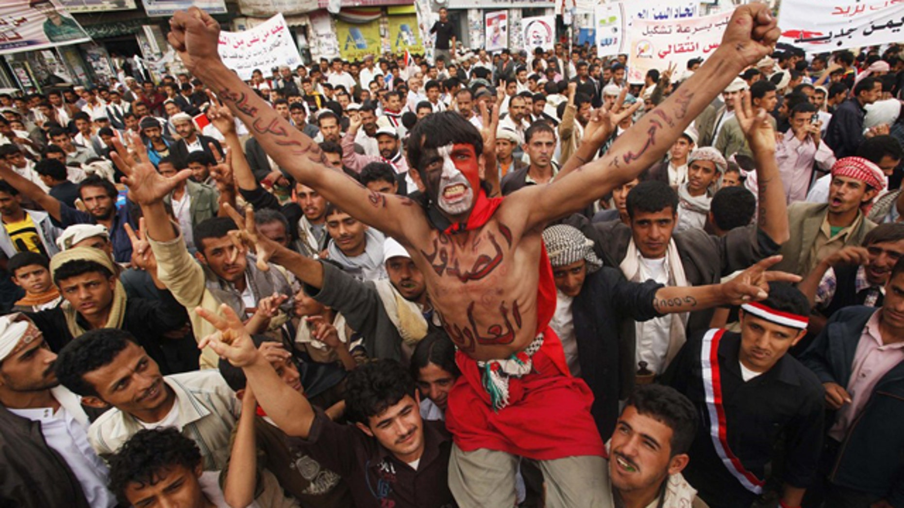 June 21: Anti-government protesters shout slogans during a demonstration to demand the ouster of Yemen's President Ali Abdullah Saleh in Sanaa.
